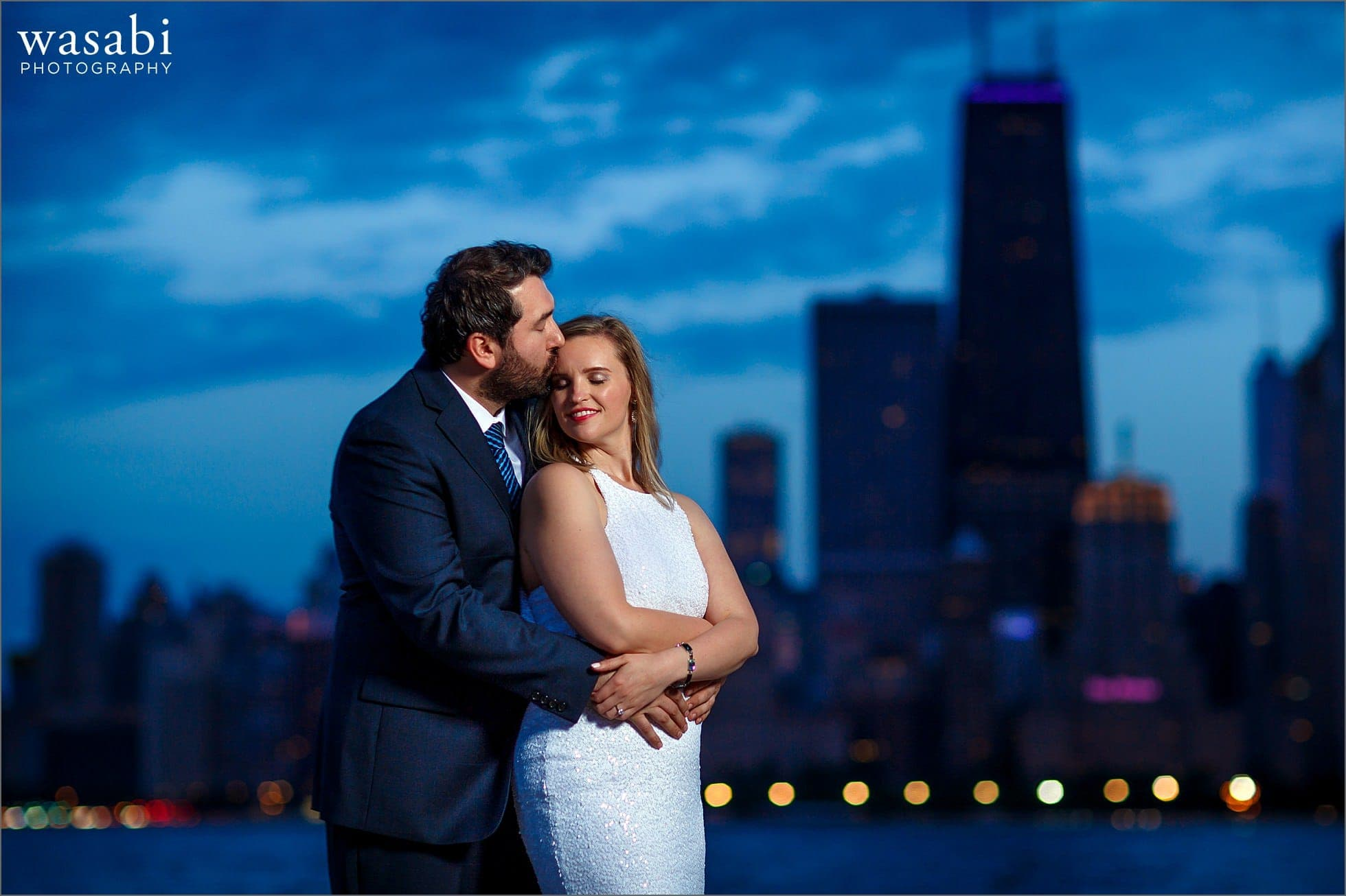 North Avenue beach engagement photos with a bride-to-be smiling during their night time engagement session with the Chicago skyline in the background