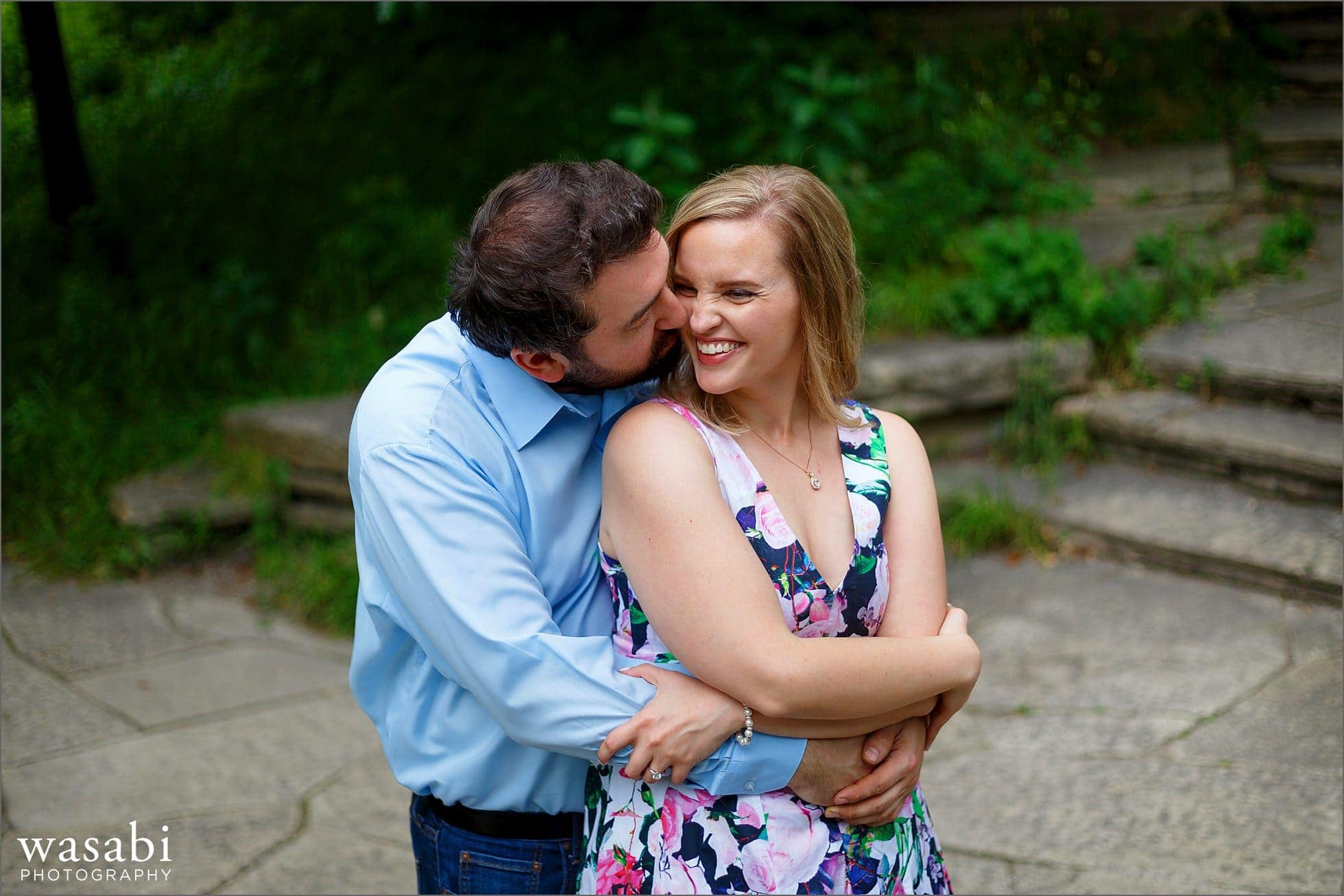 a couple kisses during their Alfred Caldwell Lily Pond engagement session in Chicagos Lincoln Park