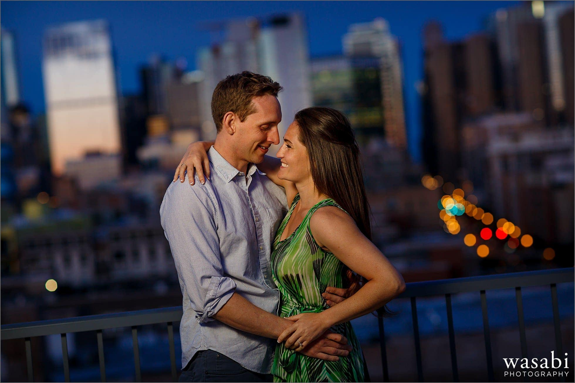 couple laughs together during West Loop engagement session on the top of Madison at Racine building roof deck