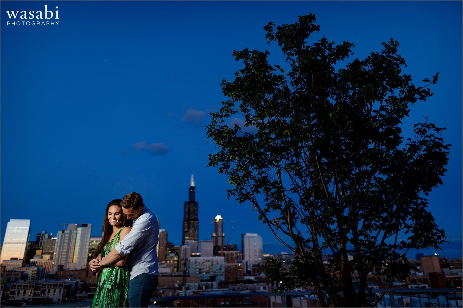 west loop engagement photos on roof deck of Madison at Racine with skyline view of Chicago