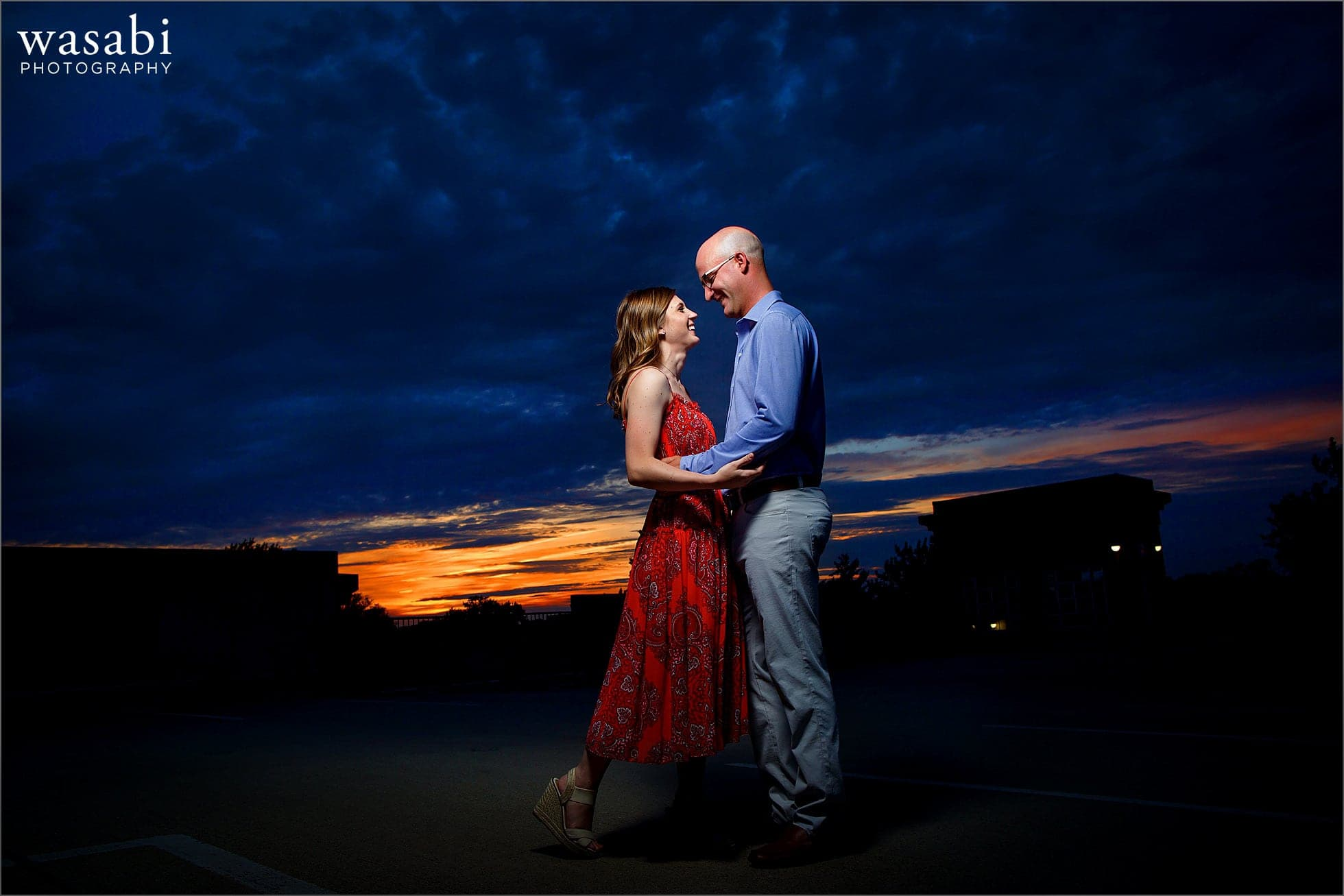 colorful engagement photos with couple posing during sunset in downtown Royal Oak, Michigan