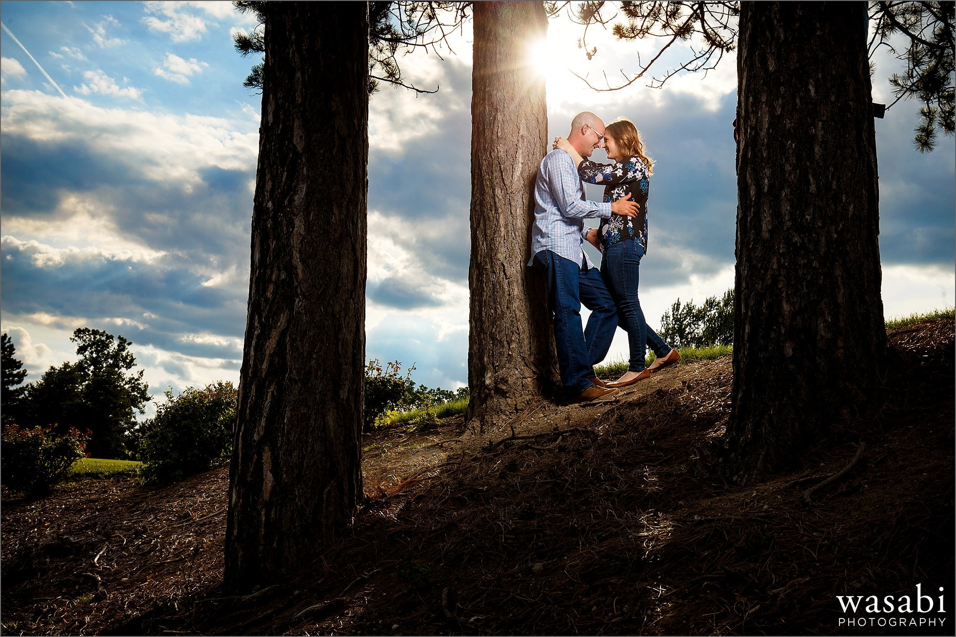 couple poses for Red Run Golf Club engagement photos in Royal Oak, Michigan.