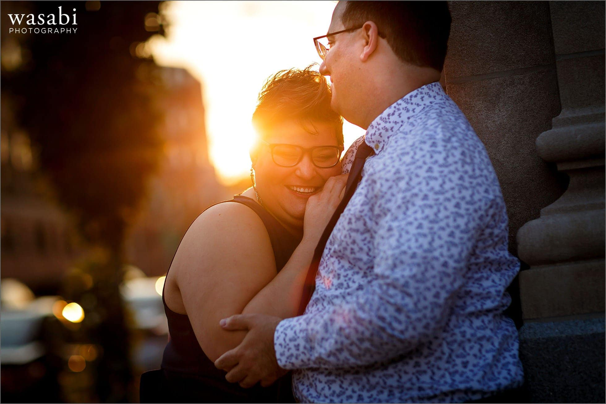 couple laughs during engagement photos in downtown Lynn Massachusetts