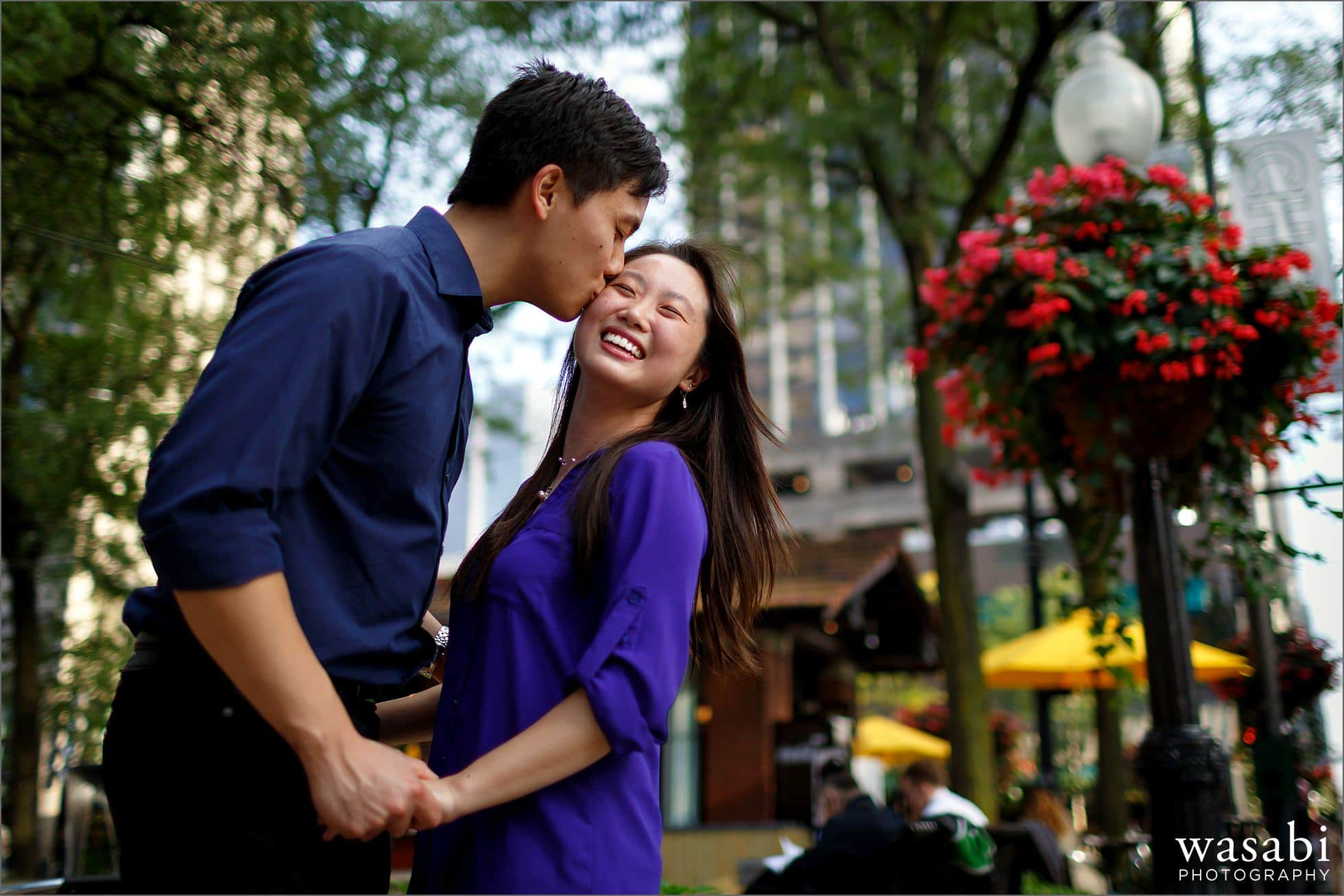 couple kisses during engagement photos at mariano park in Chicagos Gold Coast neighborhood