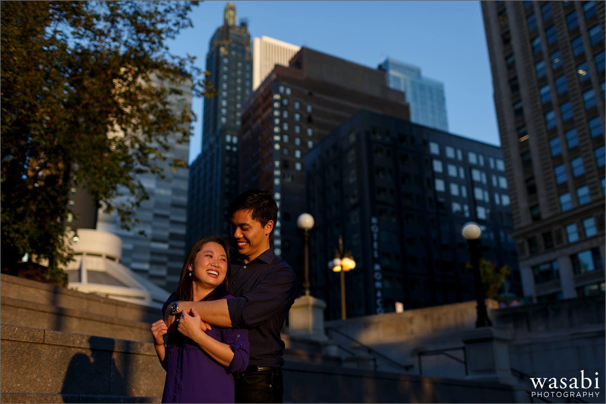 couple poses during Chicago riverwalk engagement photos in downtown Chicago