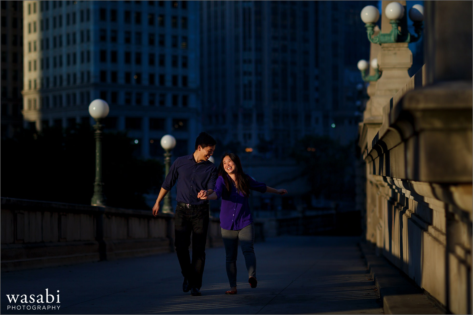 couple walks during Chicago riverwalk engagement photos in downtown Chicago