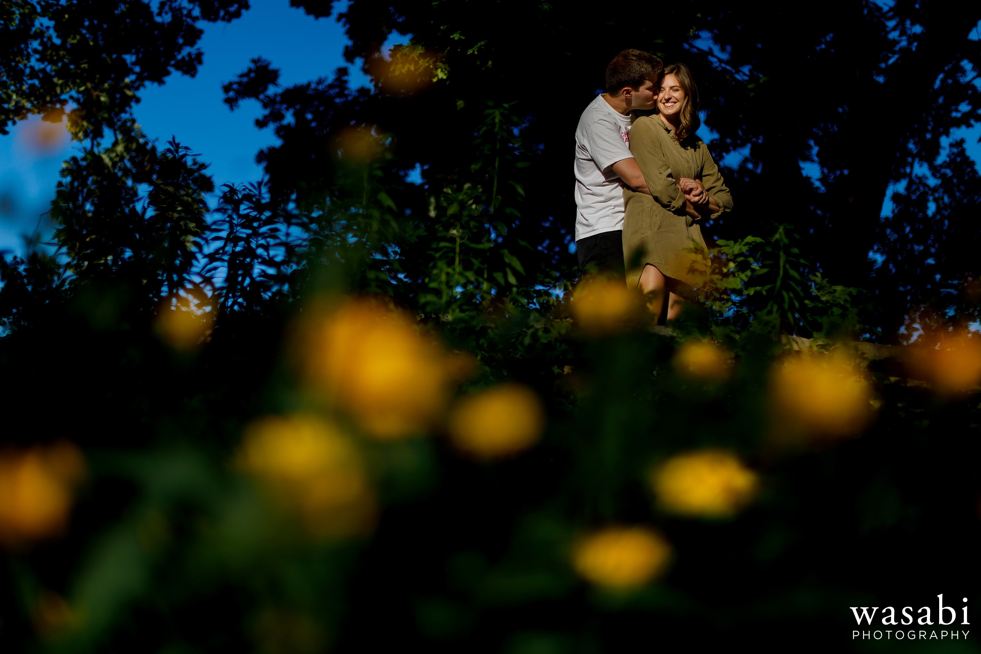 A couple poses for a portrait at Alfred Caldwell Lily Pond in Lincoln Park during their Chicago engagement session
