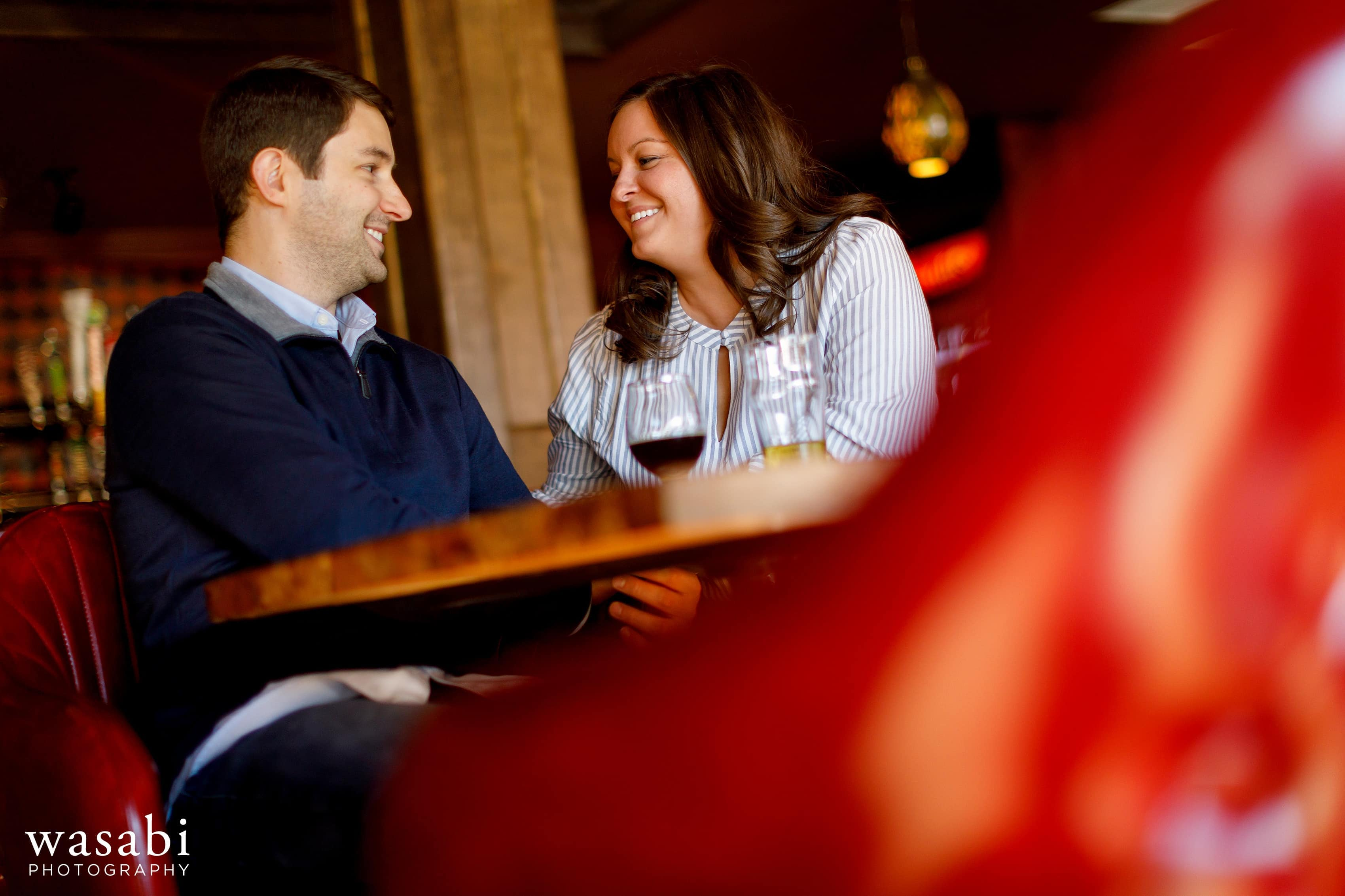 couple shares a drink at Hopcat Bar in Chicagos Lincoln Park neighborhood