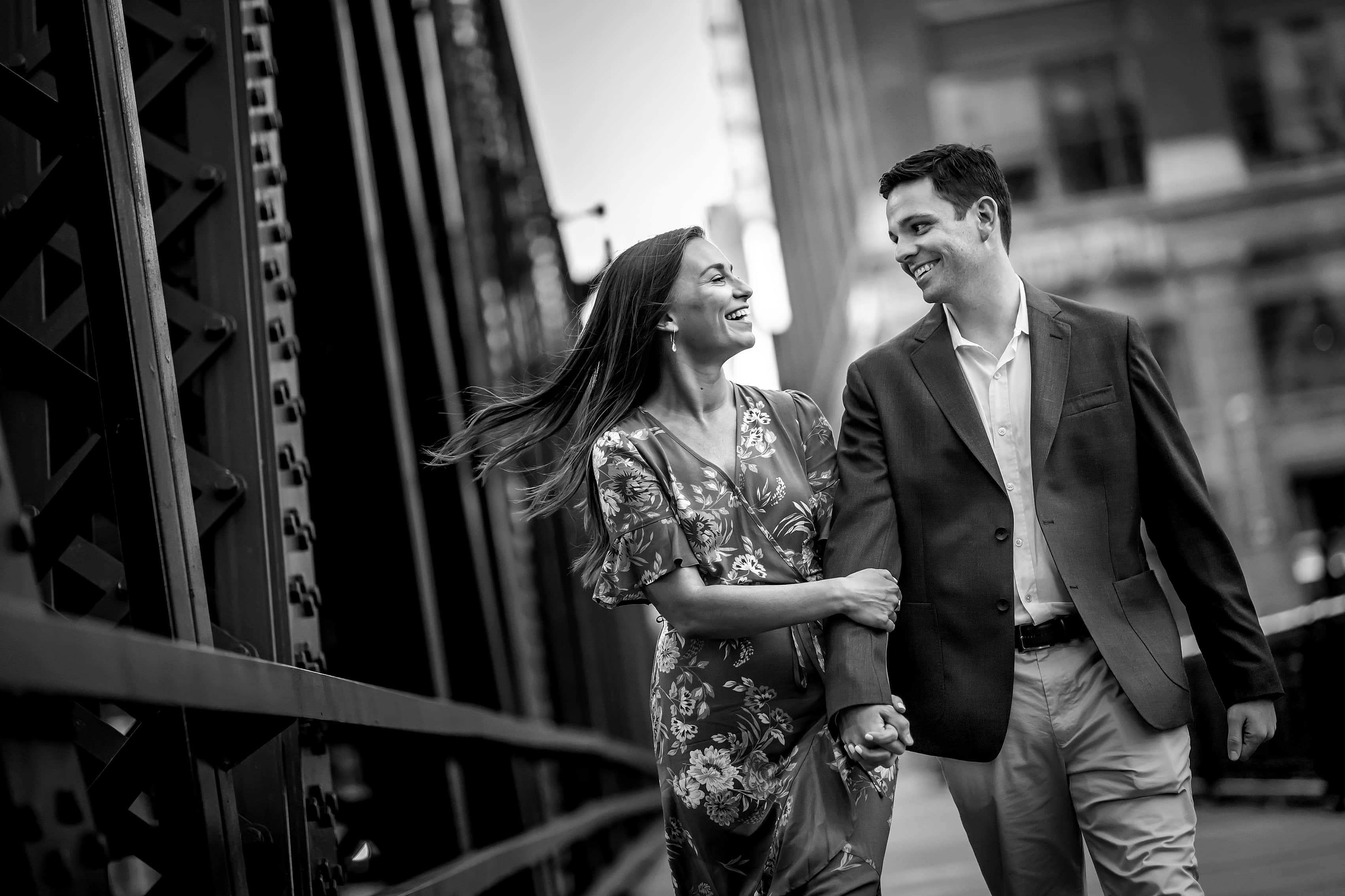 Couple walks along Wells Street bridge in downtown Chicago