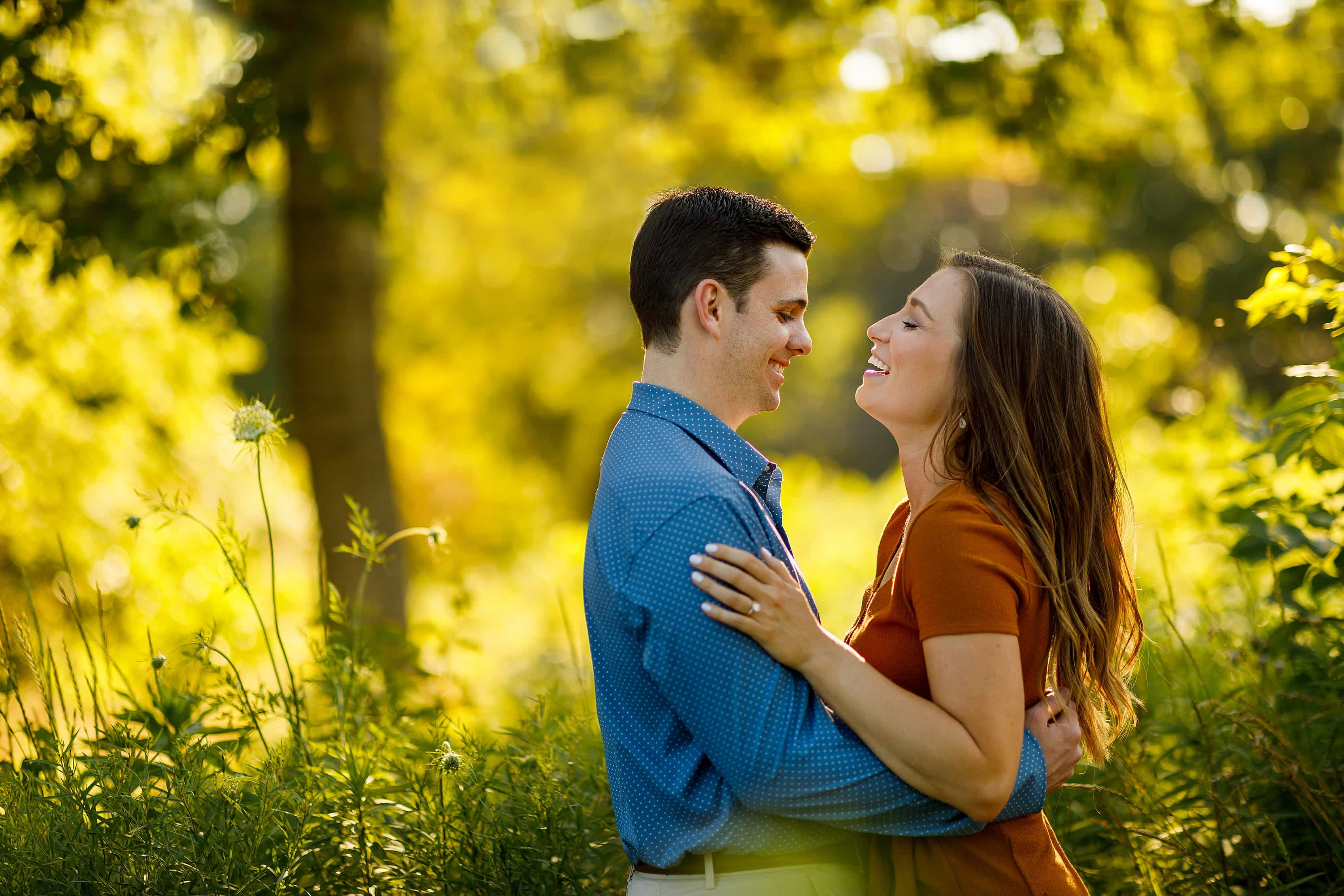 couple laughs during golden hour engagement photos at Lincoln Park in Chicago