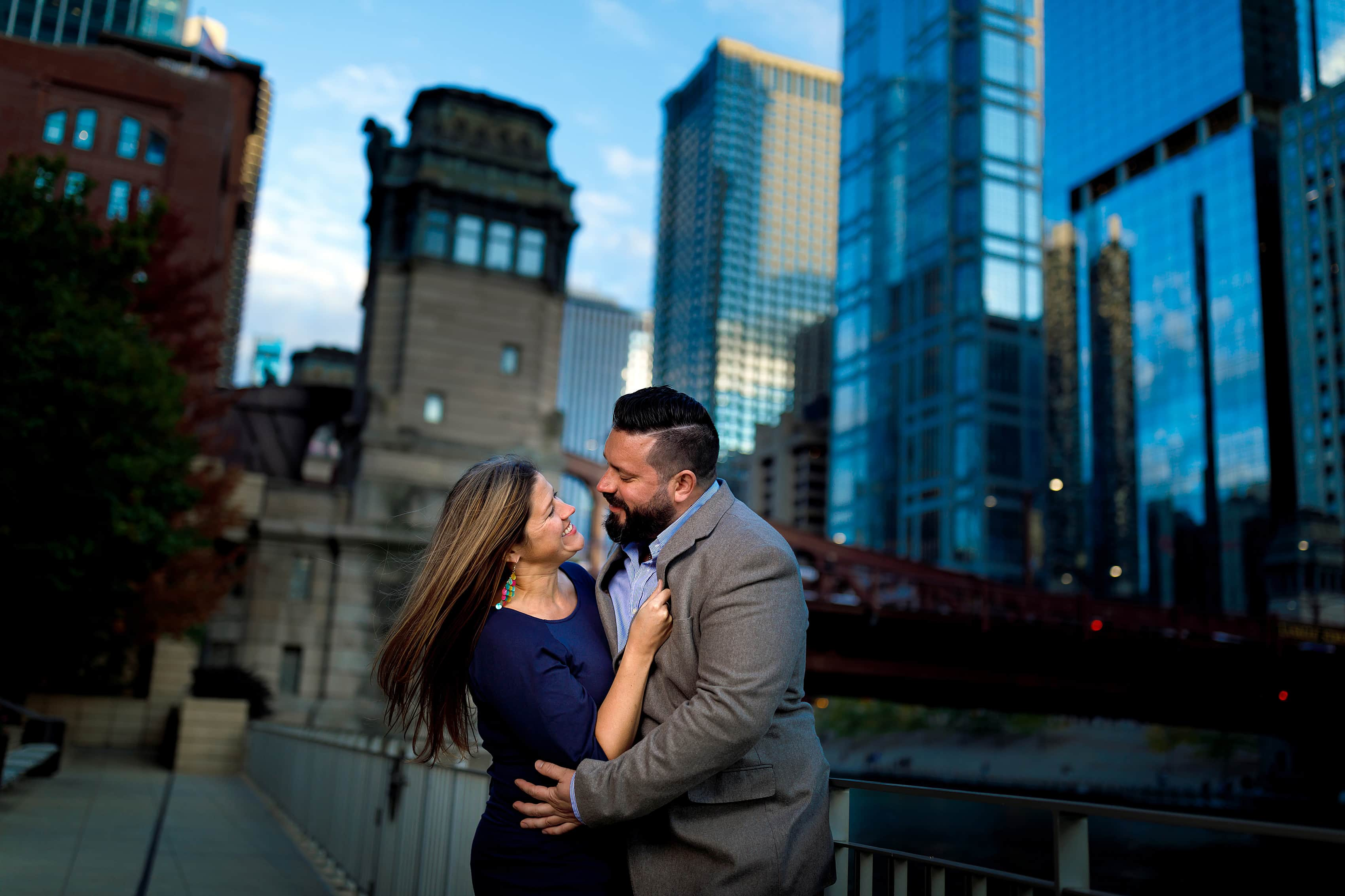 Couple laughs during engagement session on Chicago River in downtown Chicago