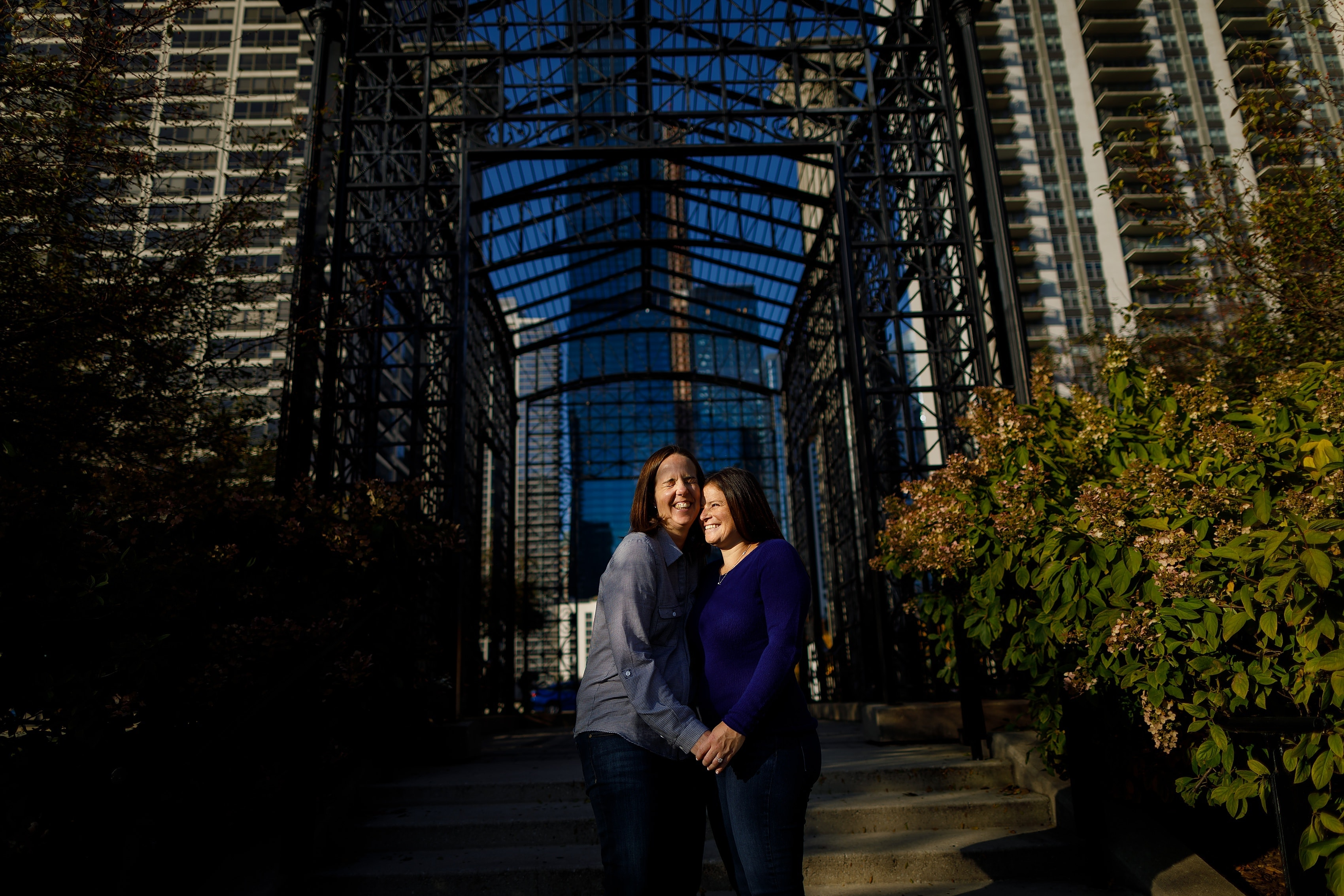 Couple hugs during engagement session at Maggie Daley Park in downtown Chicago