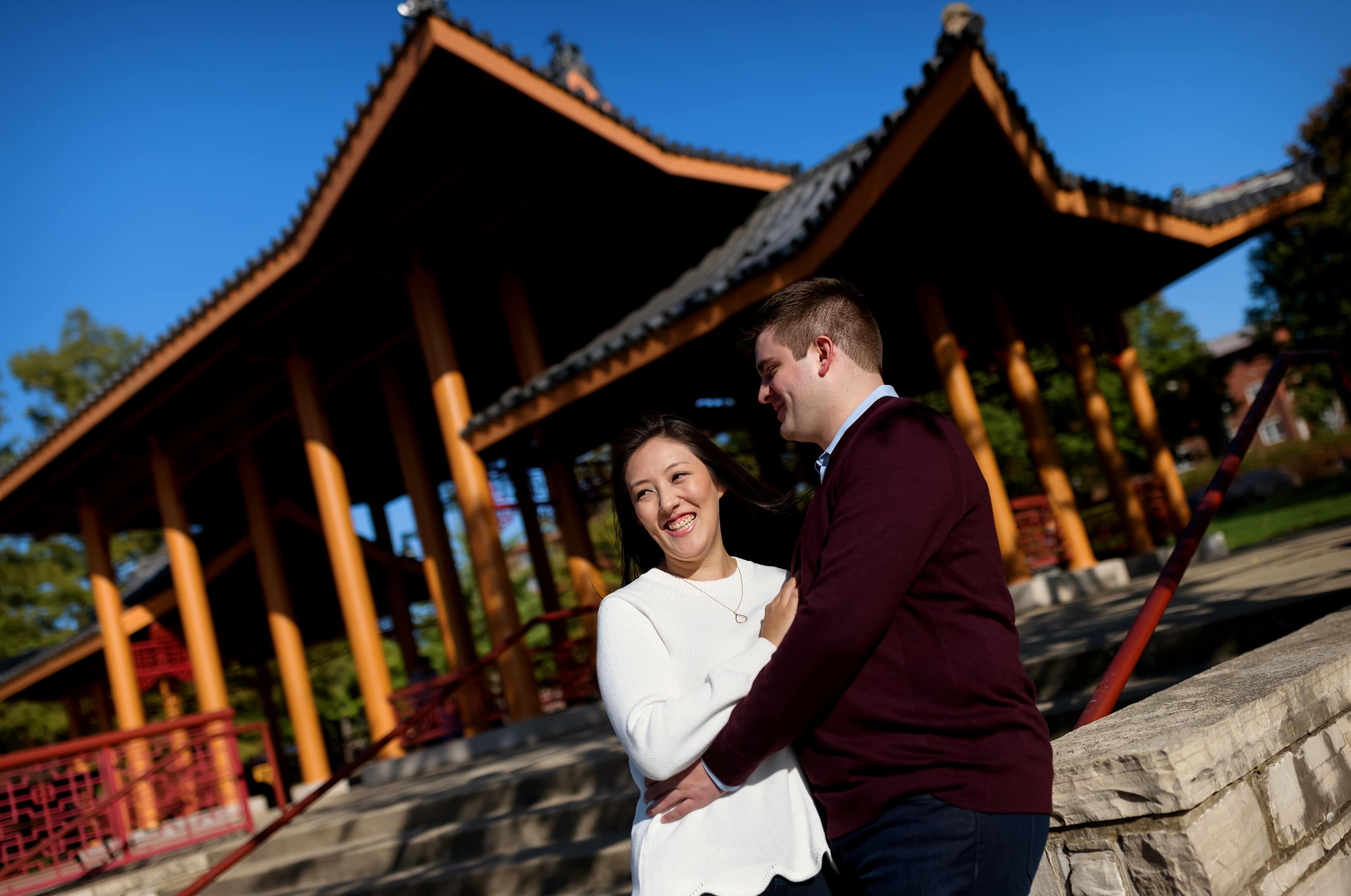 Couple poses for engagement photos at Ping Tom Memorial Park in Chicago's Chinatown neighborhood