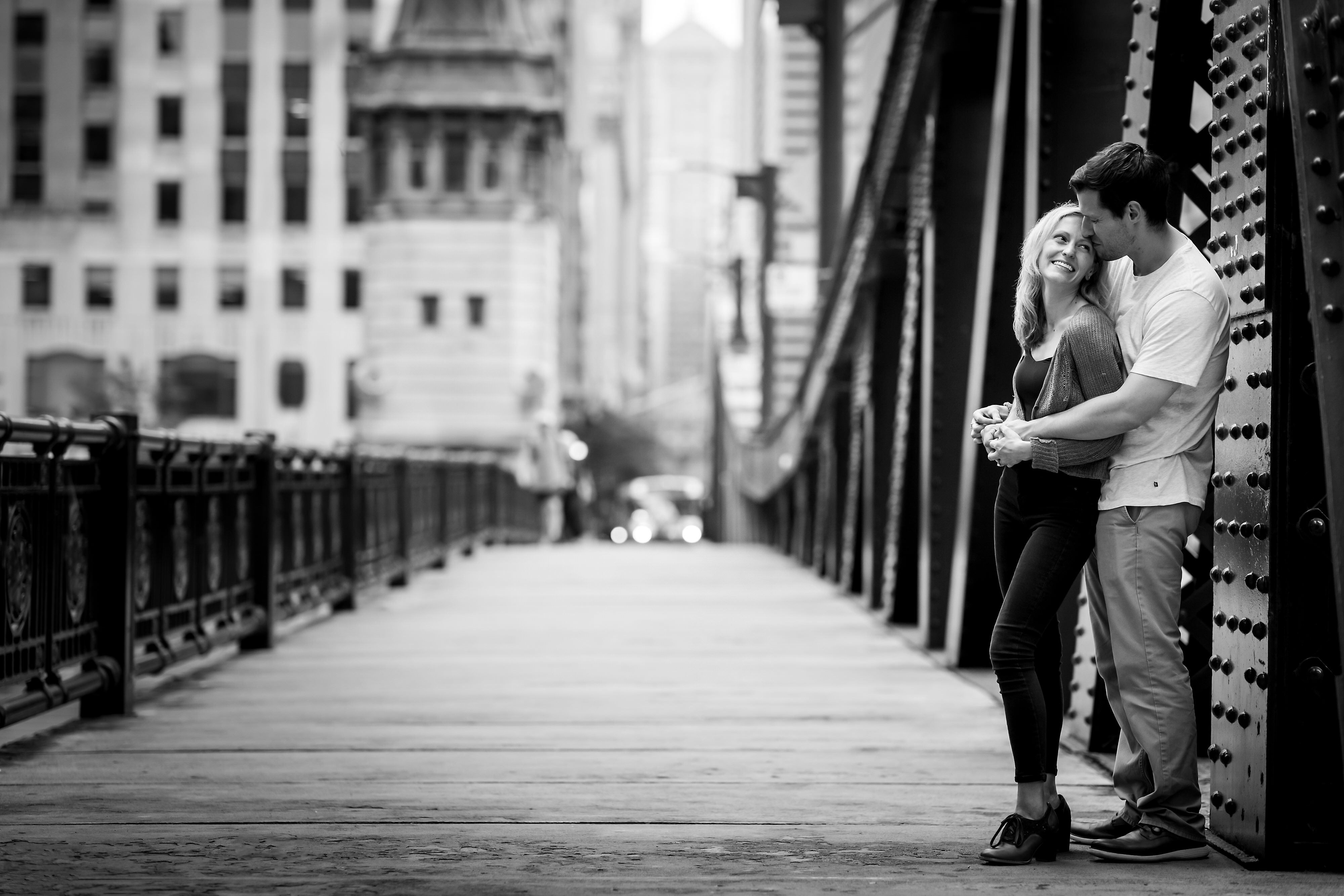 black and white photo of couple on LaSalle Street Bridge