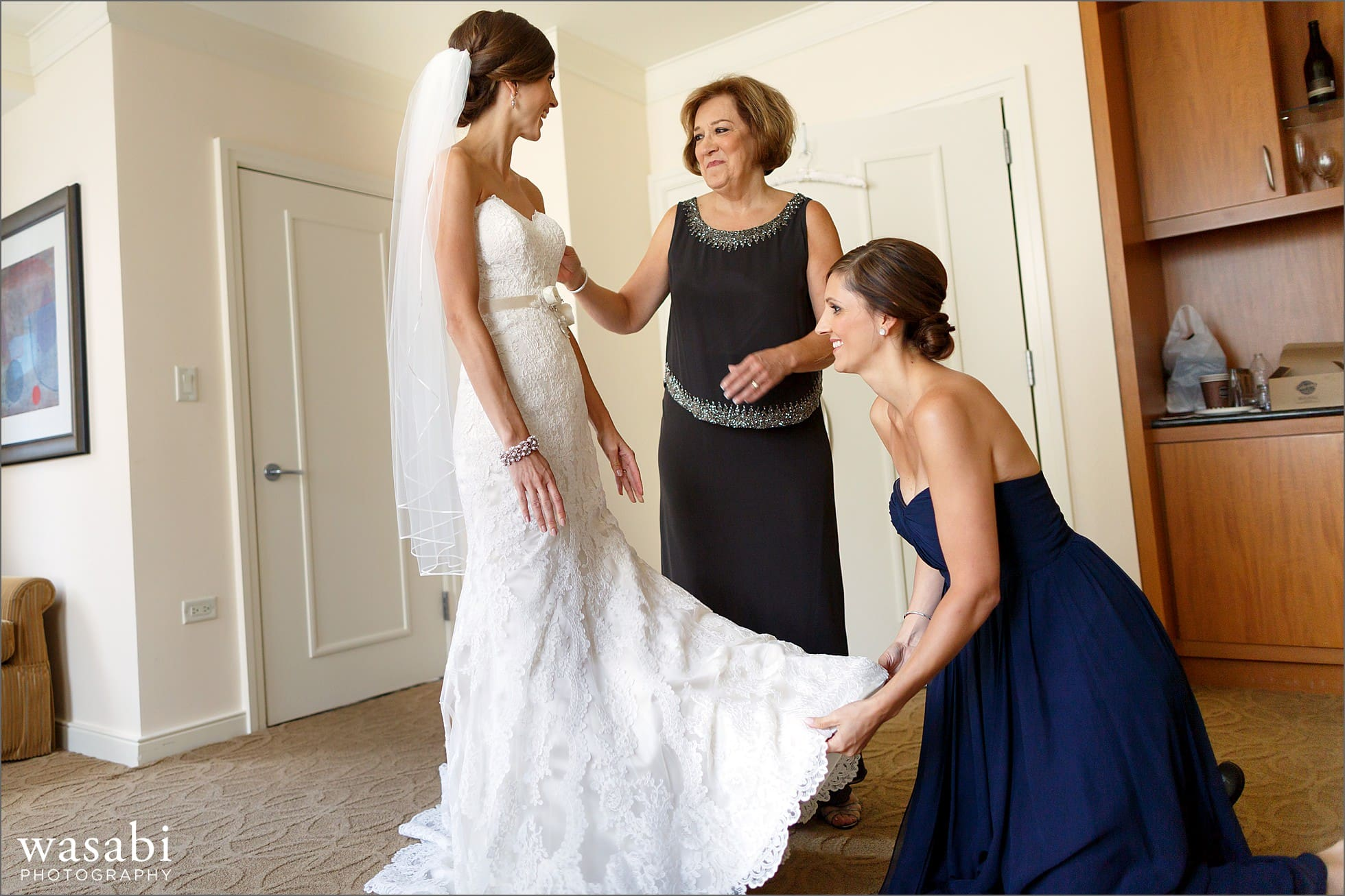 bride getting dressed at the gwen hotel