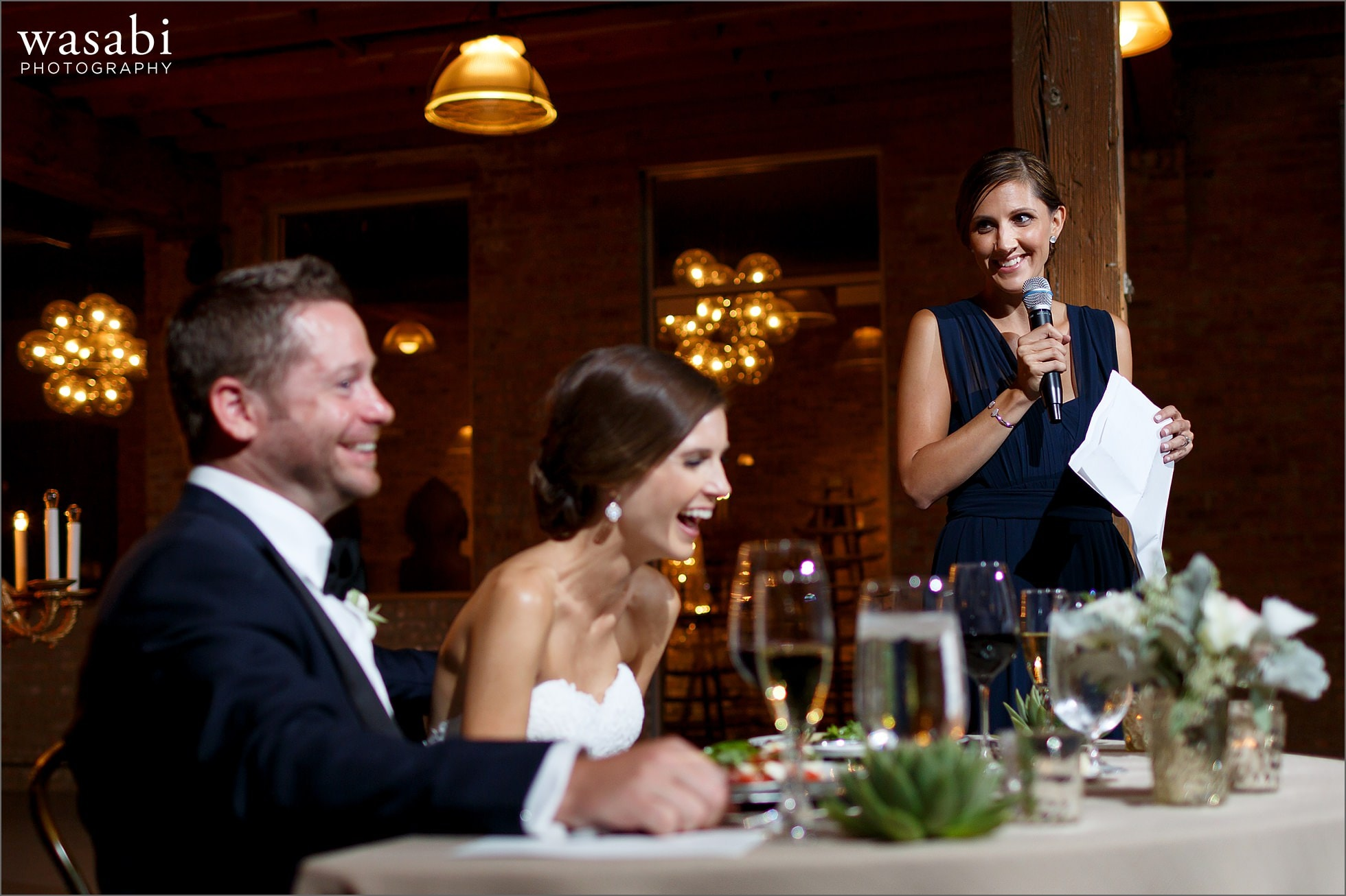 toasts during reception at architectural artifacts wedding