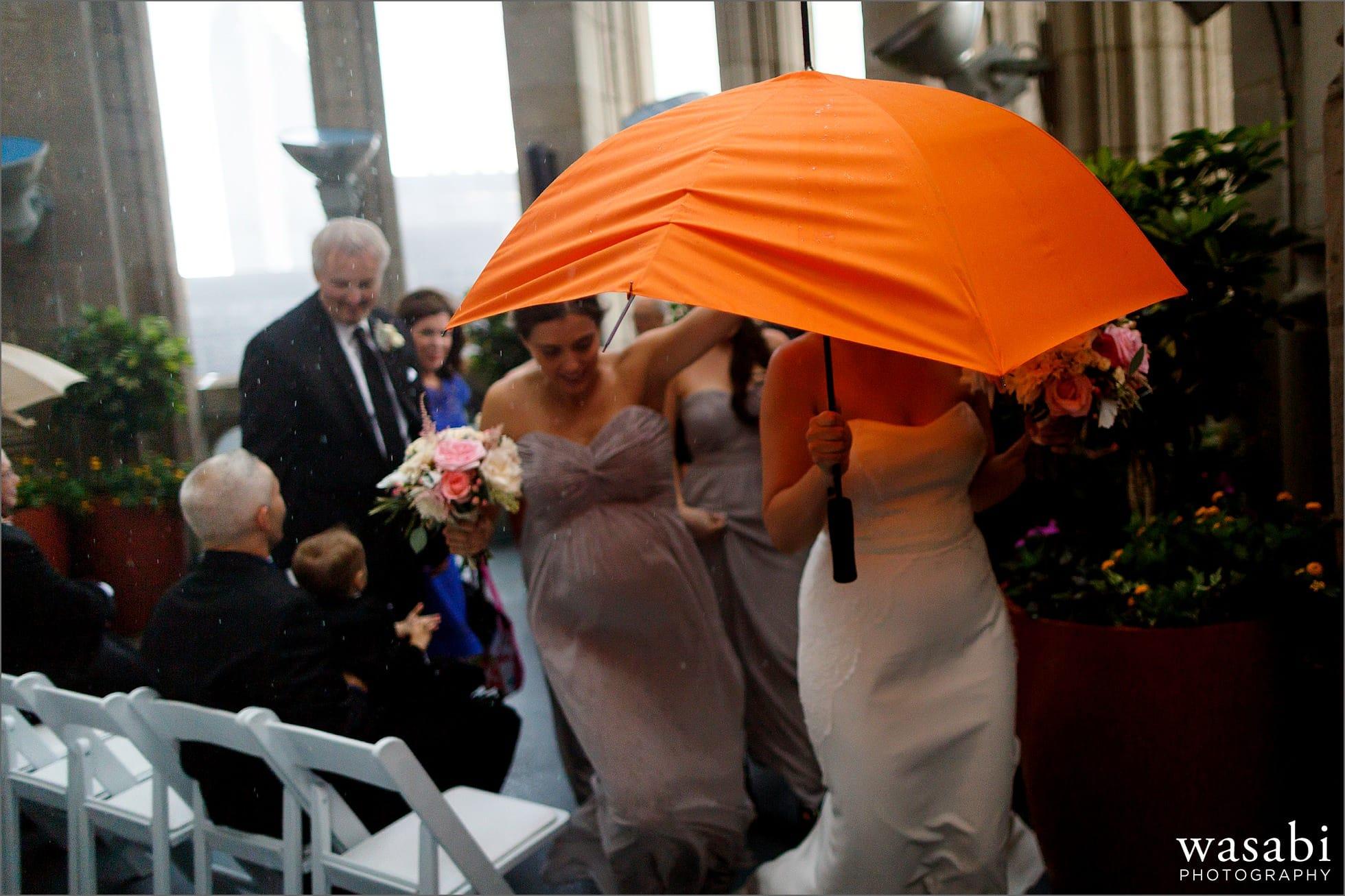 bride escapes rain umbrella during wedding ceremony chicago