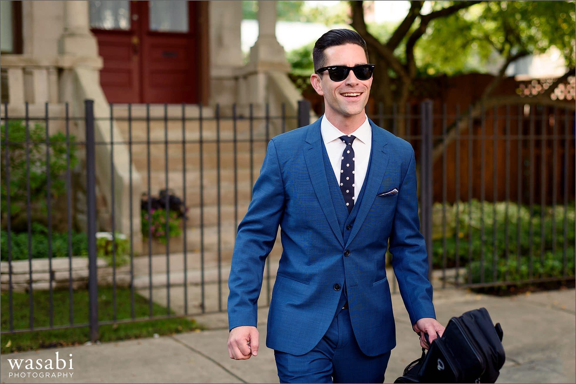 groom walking with guitar