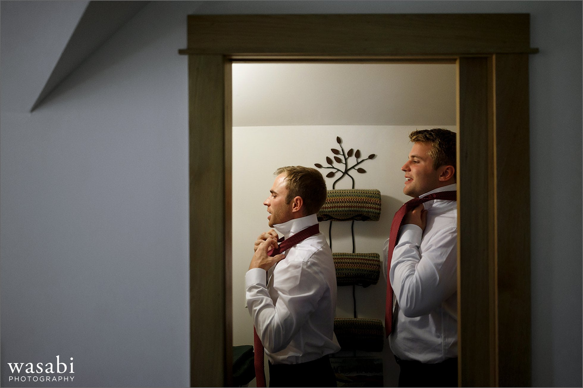 groomsmen adjust ties getting ready