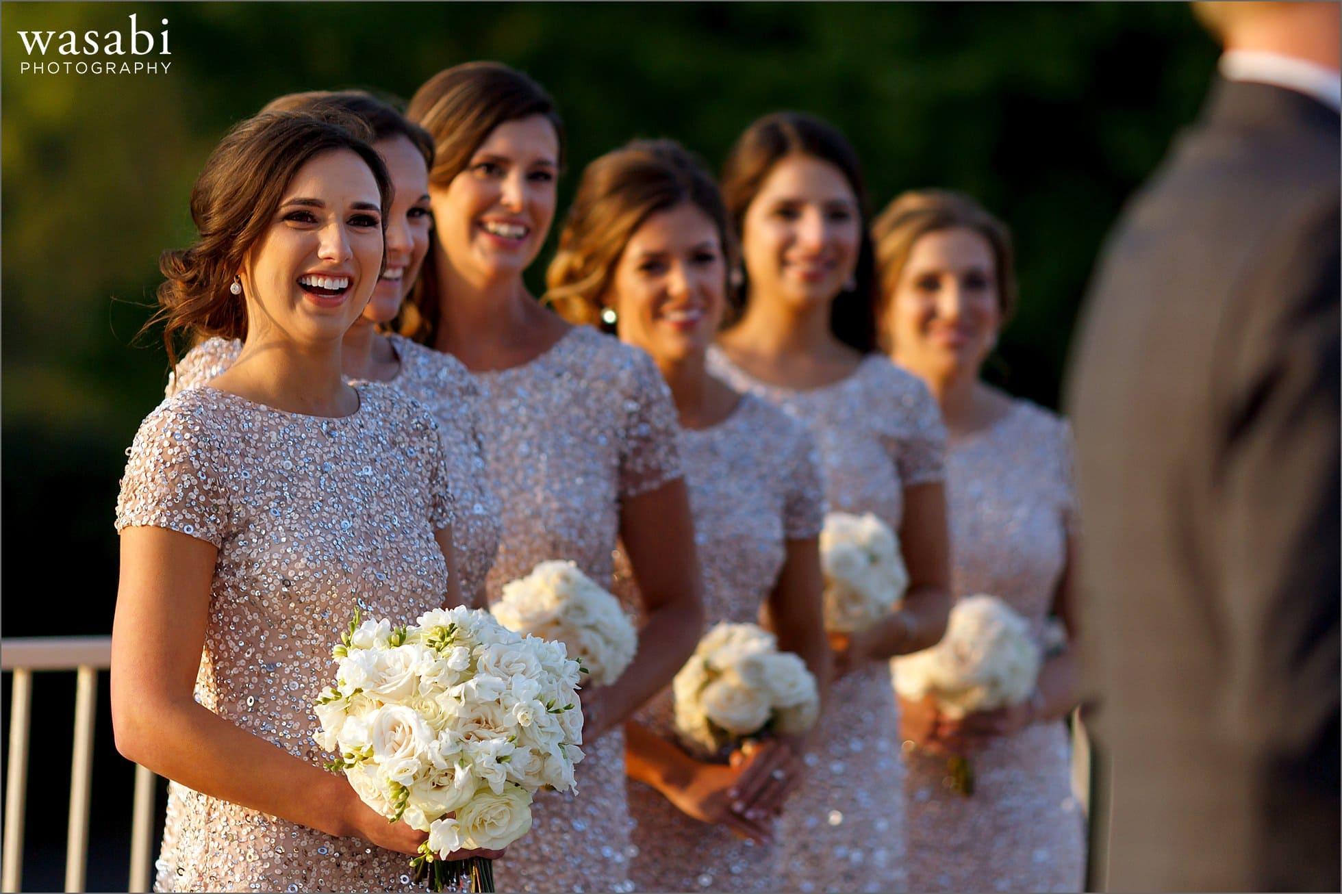 bridesmaids watch wedding ceremony