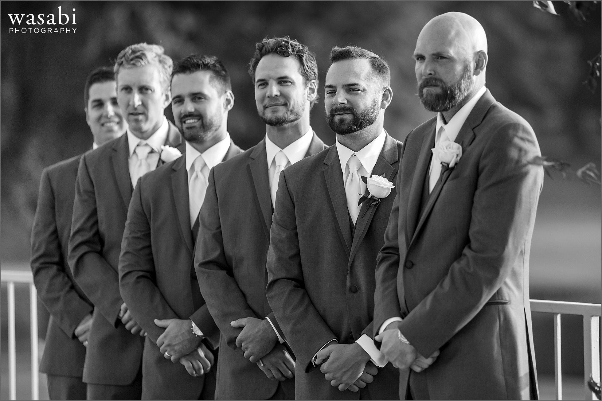 groomsmen watch wedding ceremony