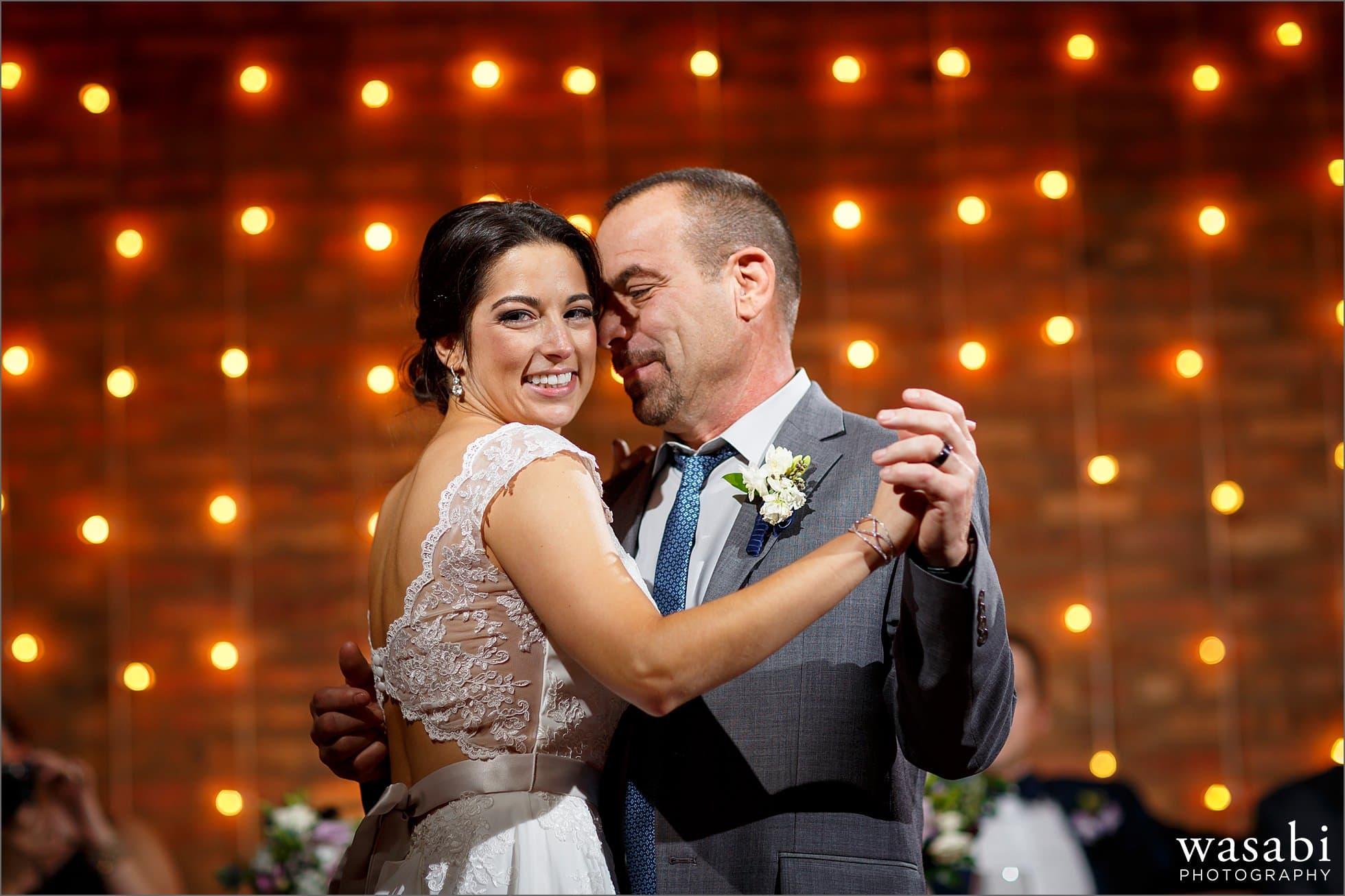 bride dances with father wedding photos