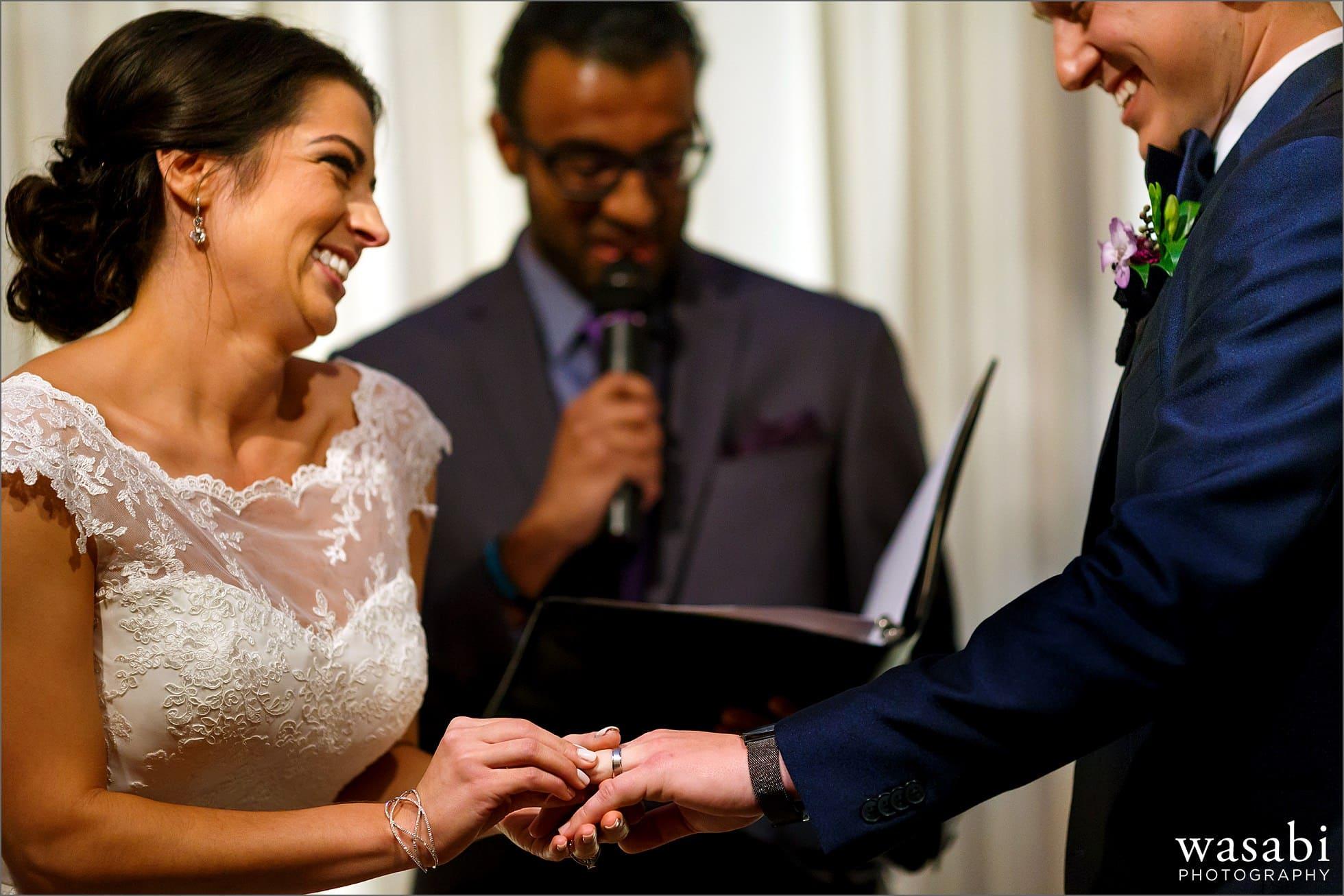 bride groom exchange wedding rings photo