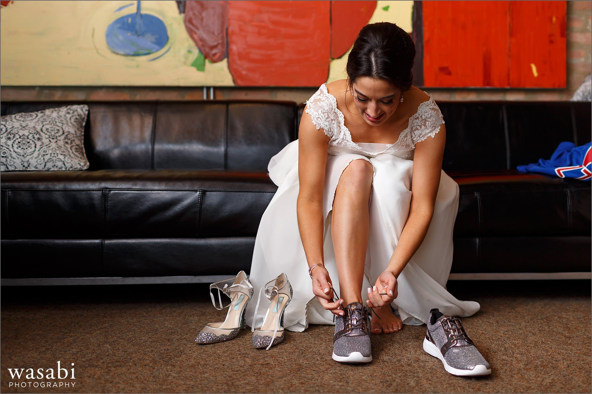 bride puts on dancing shoes literally
