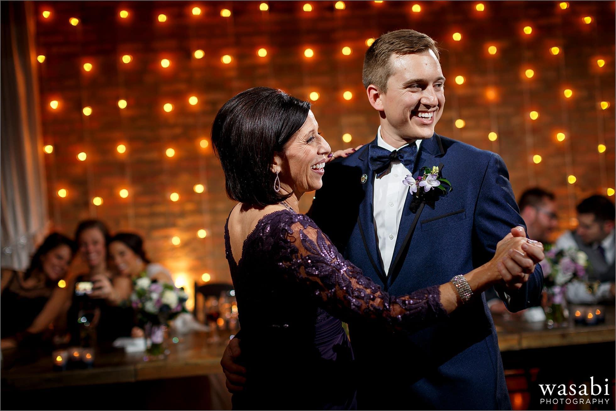 groom dances with mom wedding photos