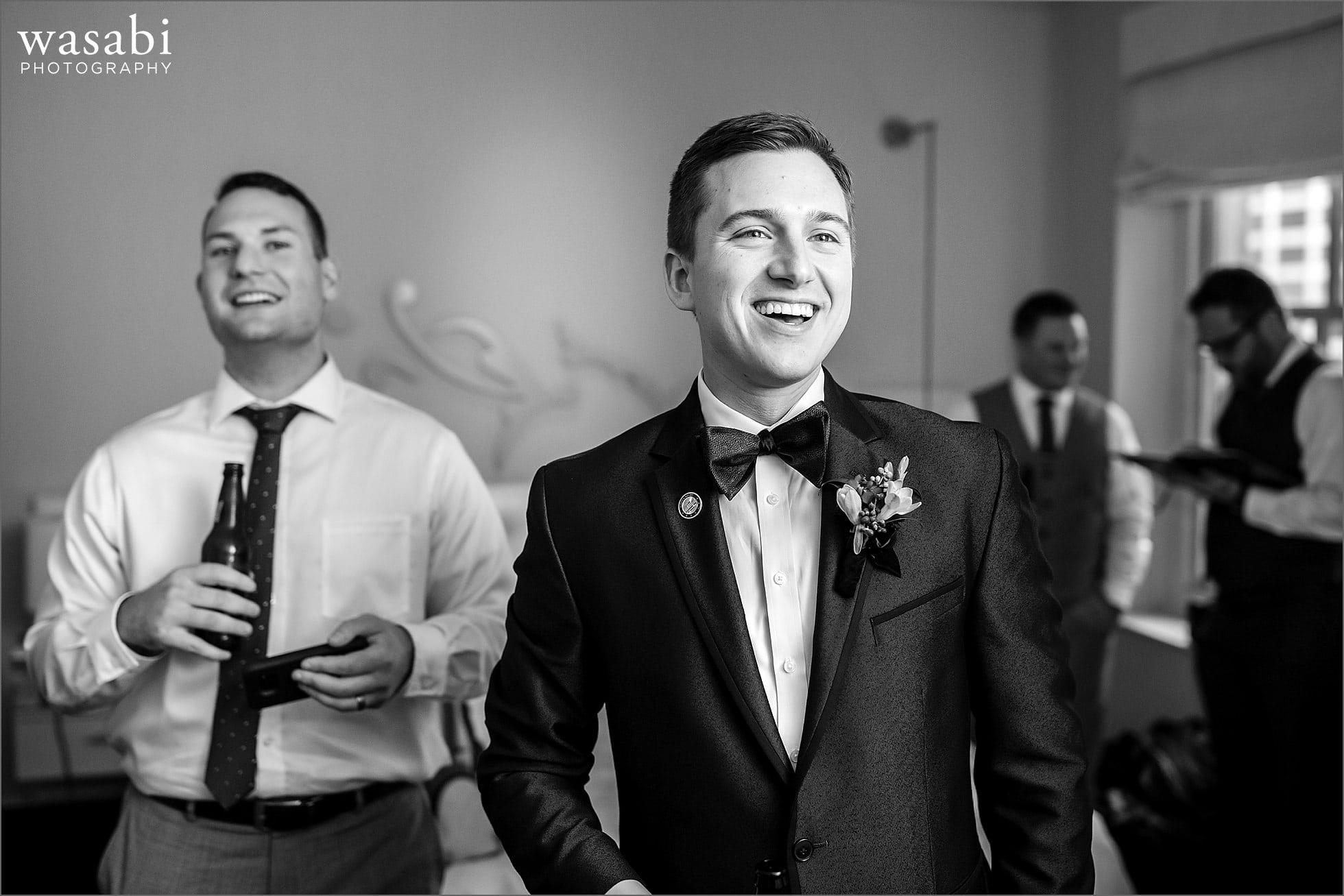 groom getting ready w hotel wedding photos