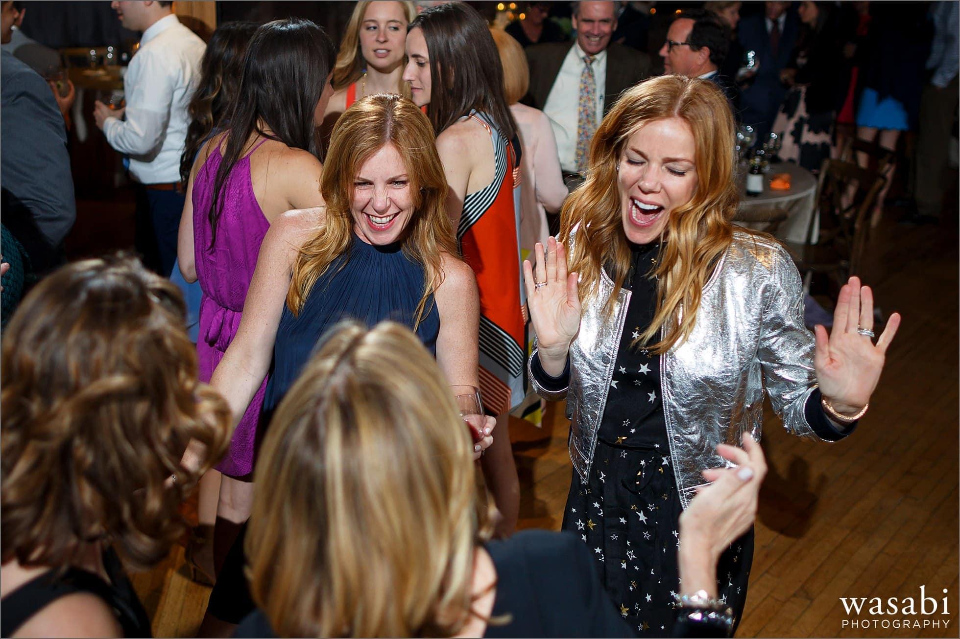 a group of women dancing during Skyline Loft wedding reception