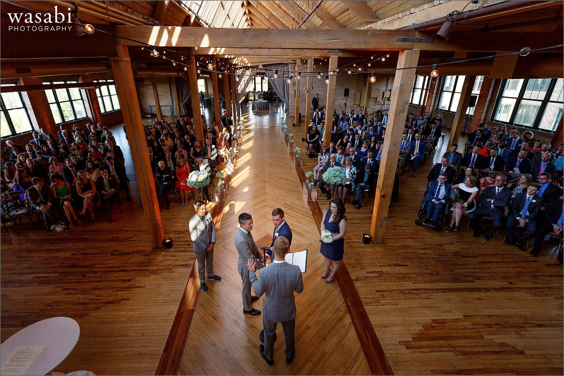 extreme wide angle showing entire venue during a wedding ceremony at Skyline Loft at Bridgeport Art Center in Chicago