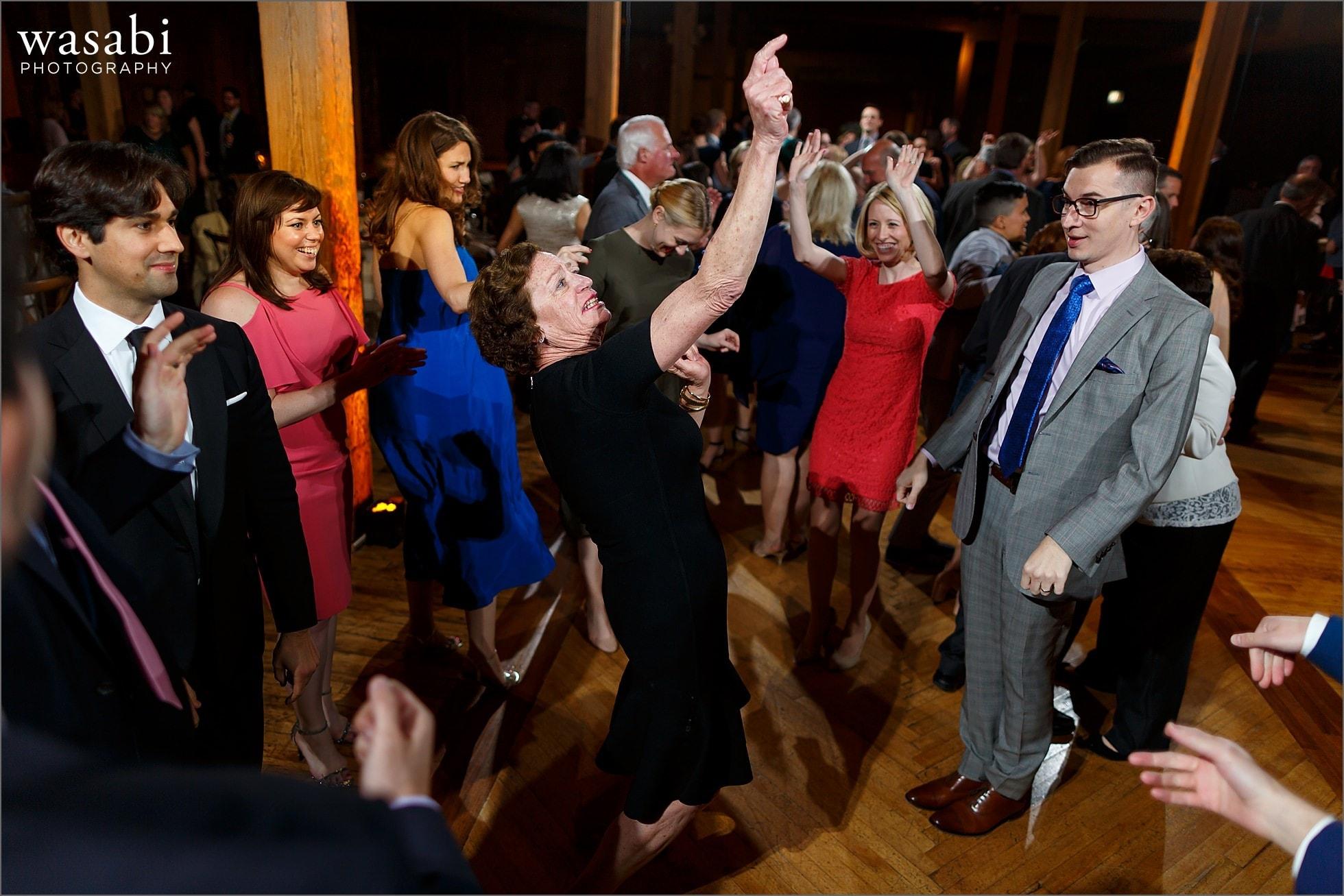 grandmother shows dance moves during wedding reception at Bridgeport Art Centers Skyline Loft