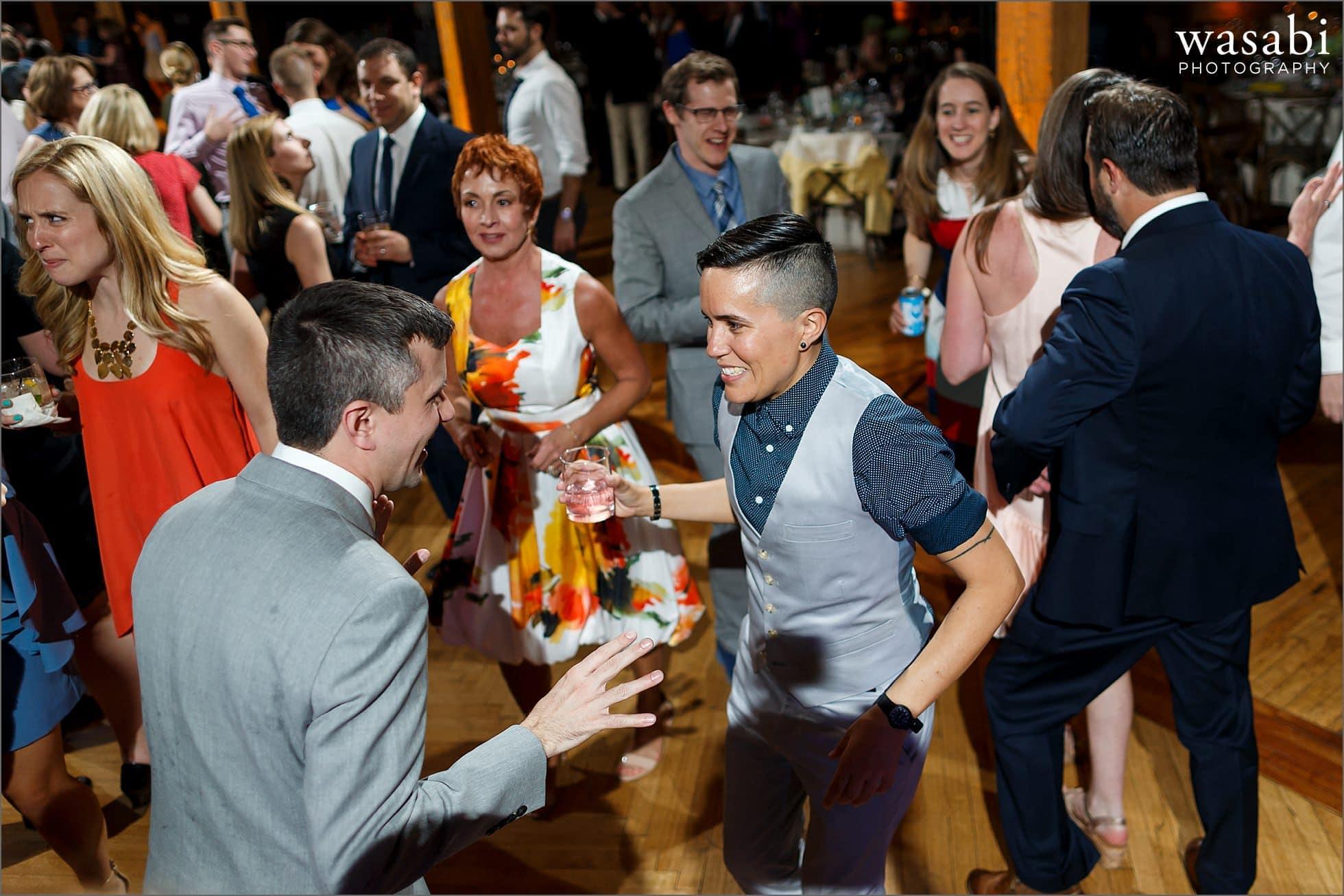 groom and sister dance during Skyline Loft wedding reception at Bridgeport Art Center in Chicago