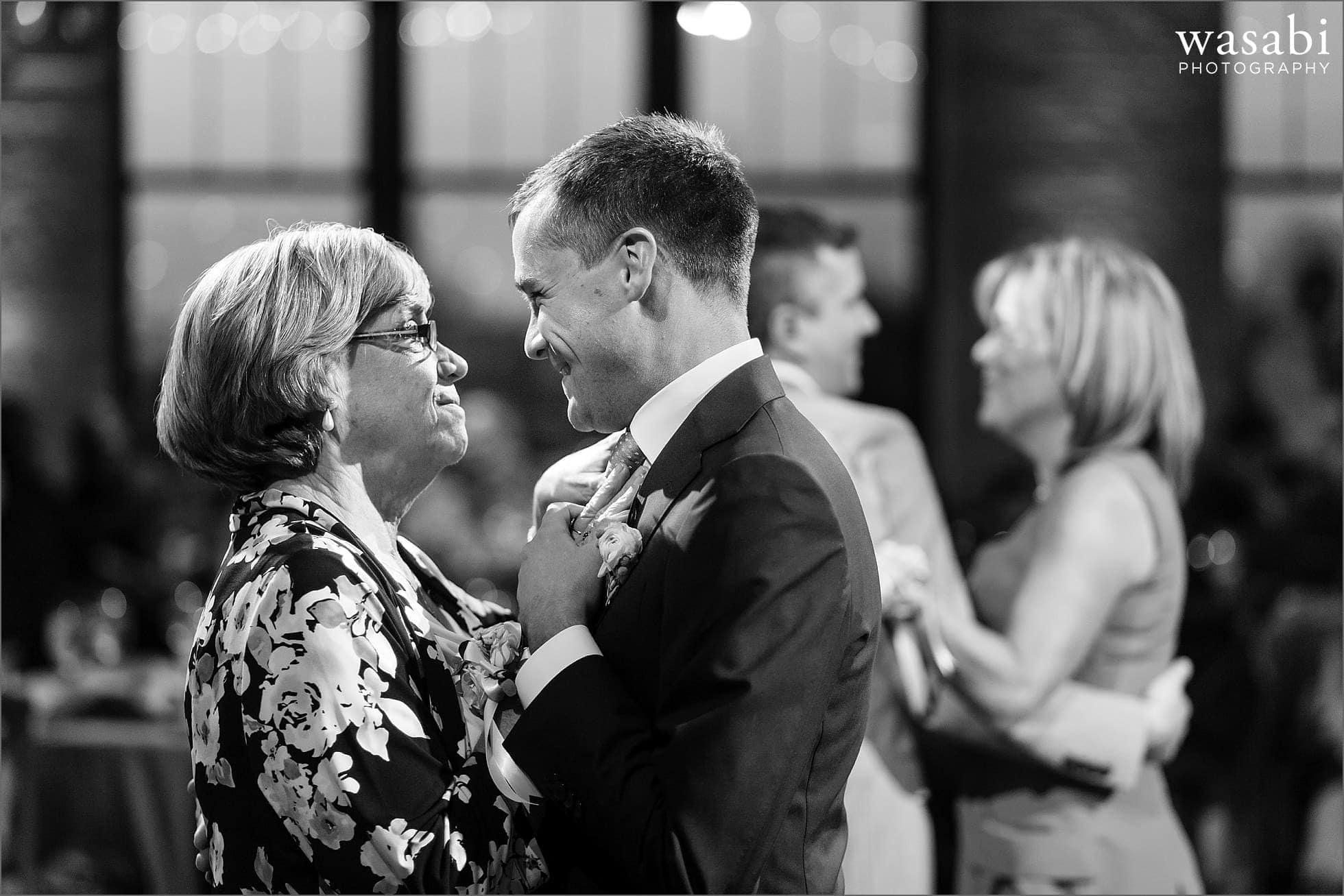Groom dances with mom at wedding reception