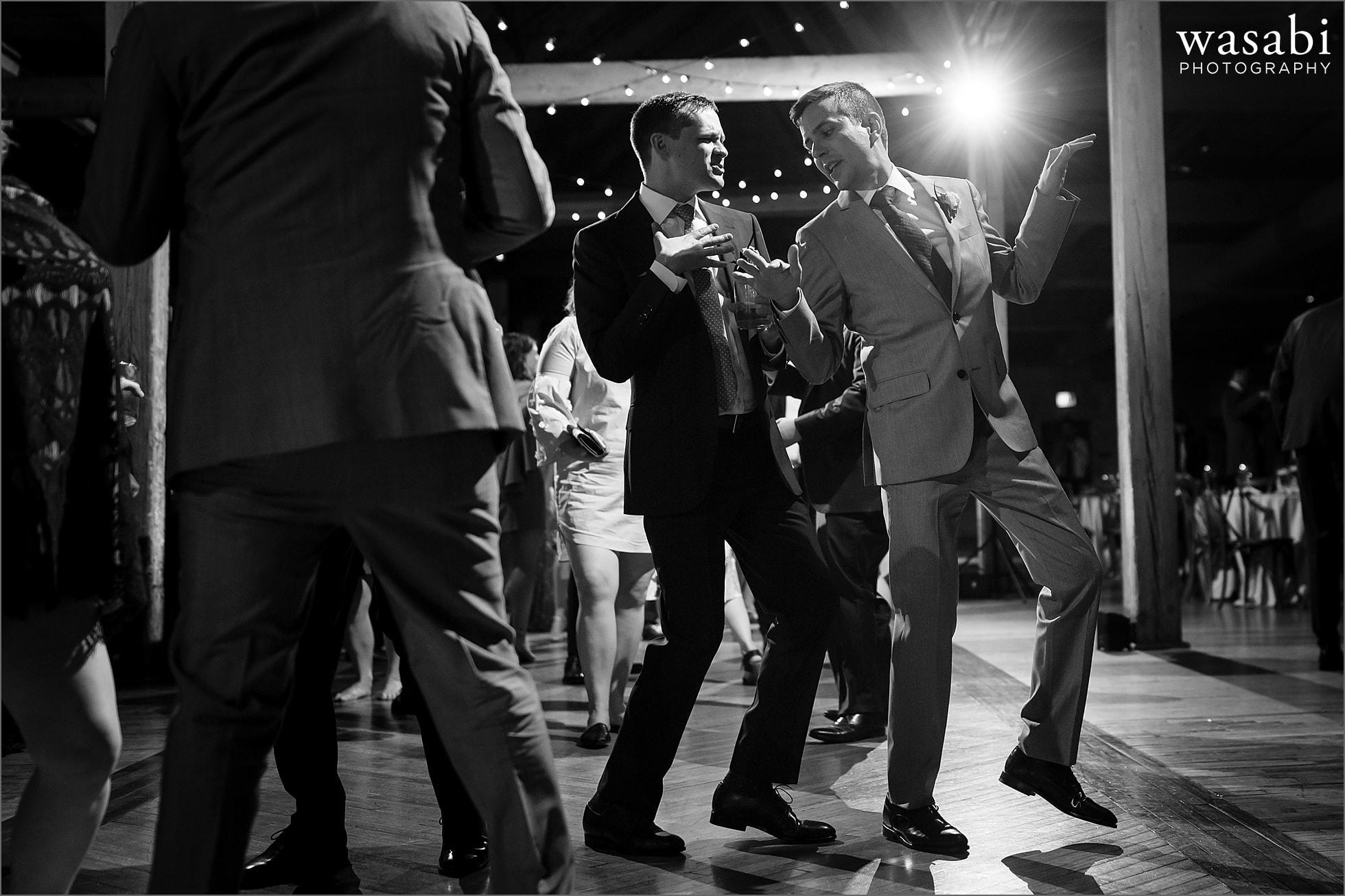 Grooms dance during their Skyline Loft wedding reception at Bridgeport Art Center in Chicago