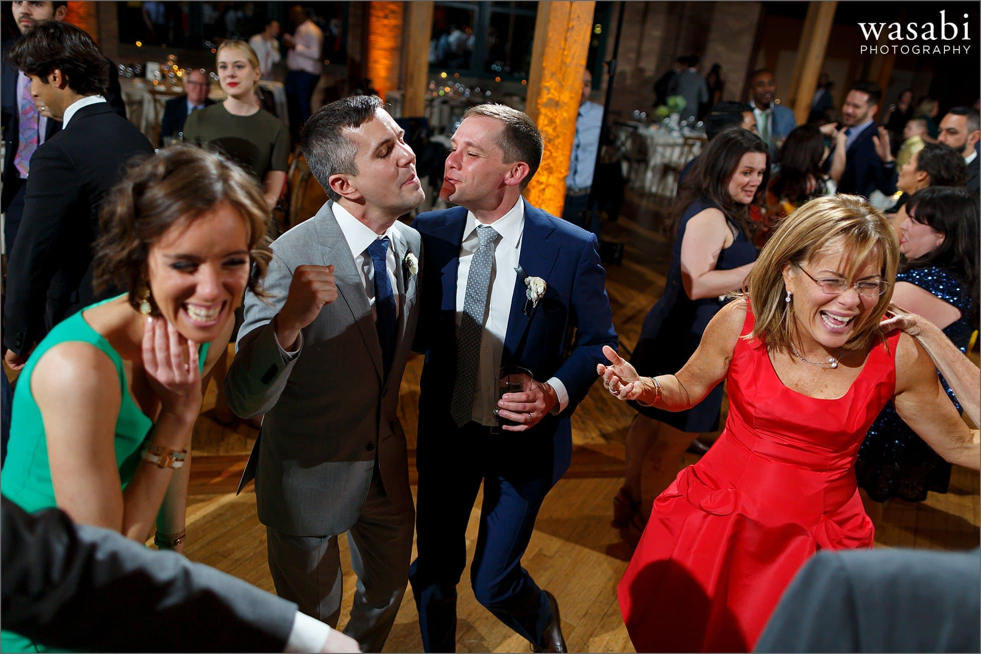 grooms dance with their family during wedding reception at Bridgeport Art Centers Skyline Loft