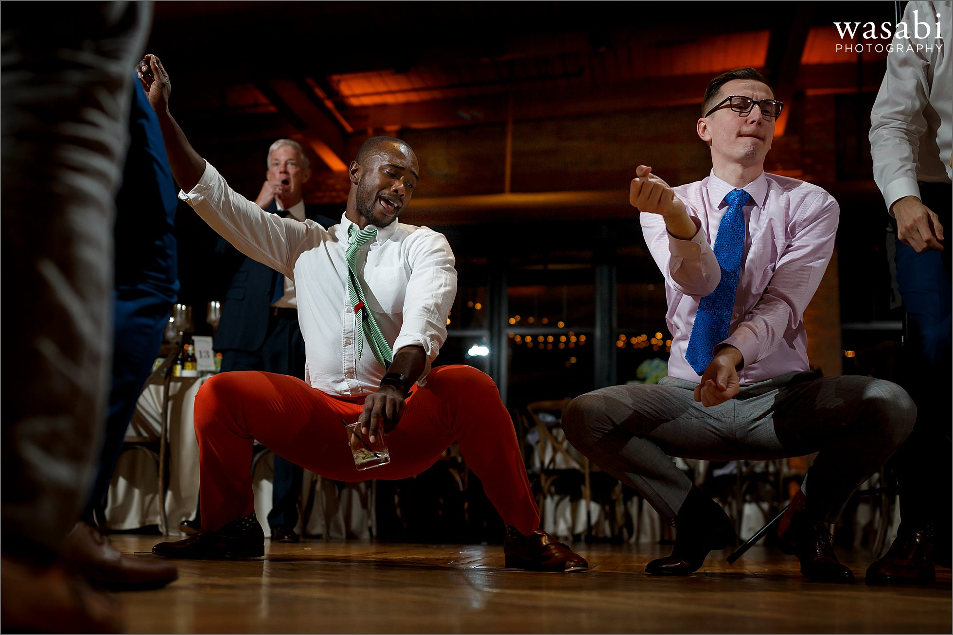 guys get down while dancing during Skyline Loft wedding reception at Bridgeport Art Center