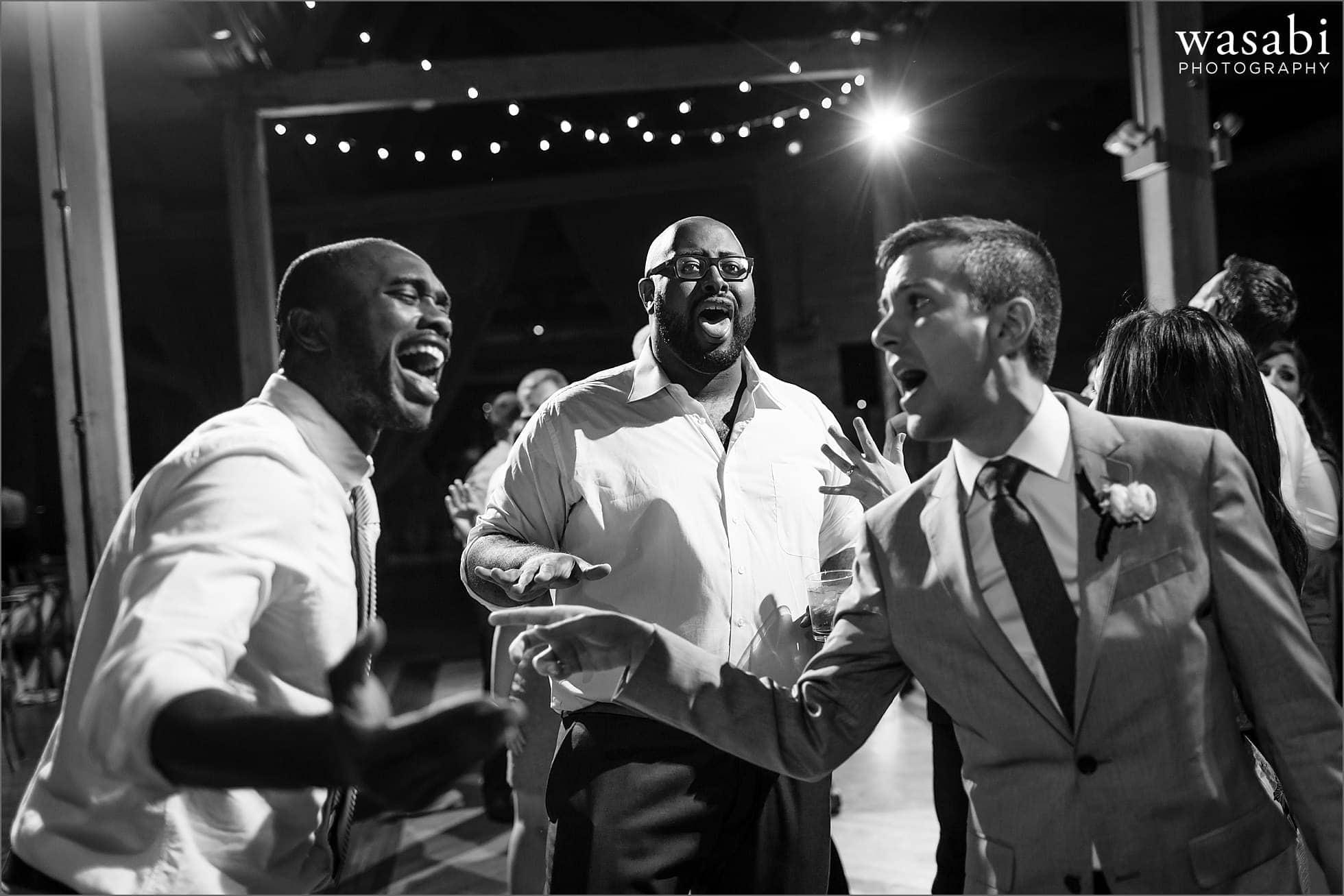 guys sing along while dancing at wedding reception at Bridgeport Art Centers Skyline Loft