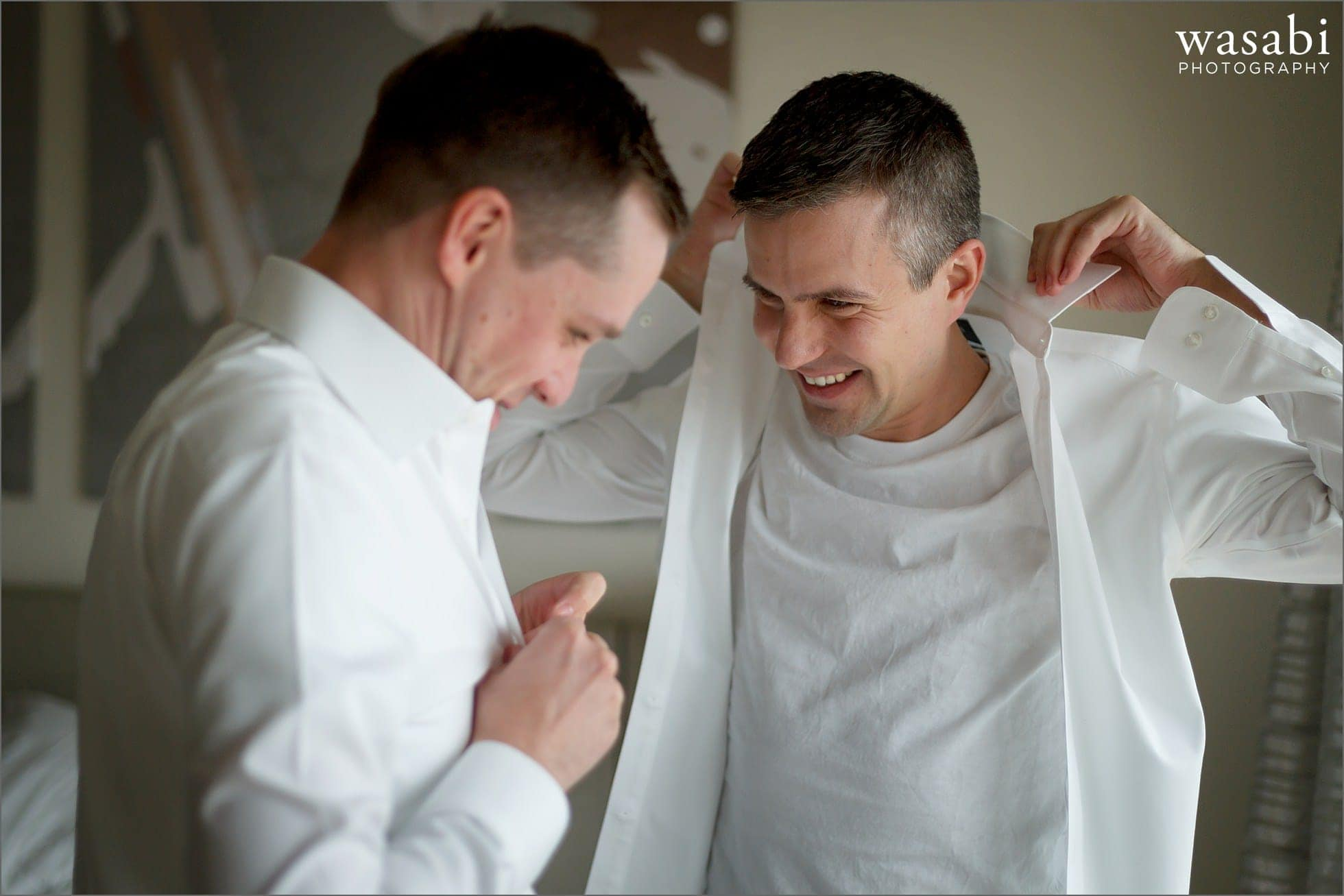 two grooms get ready together for their wedding at bridgeport art center in chicago