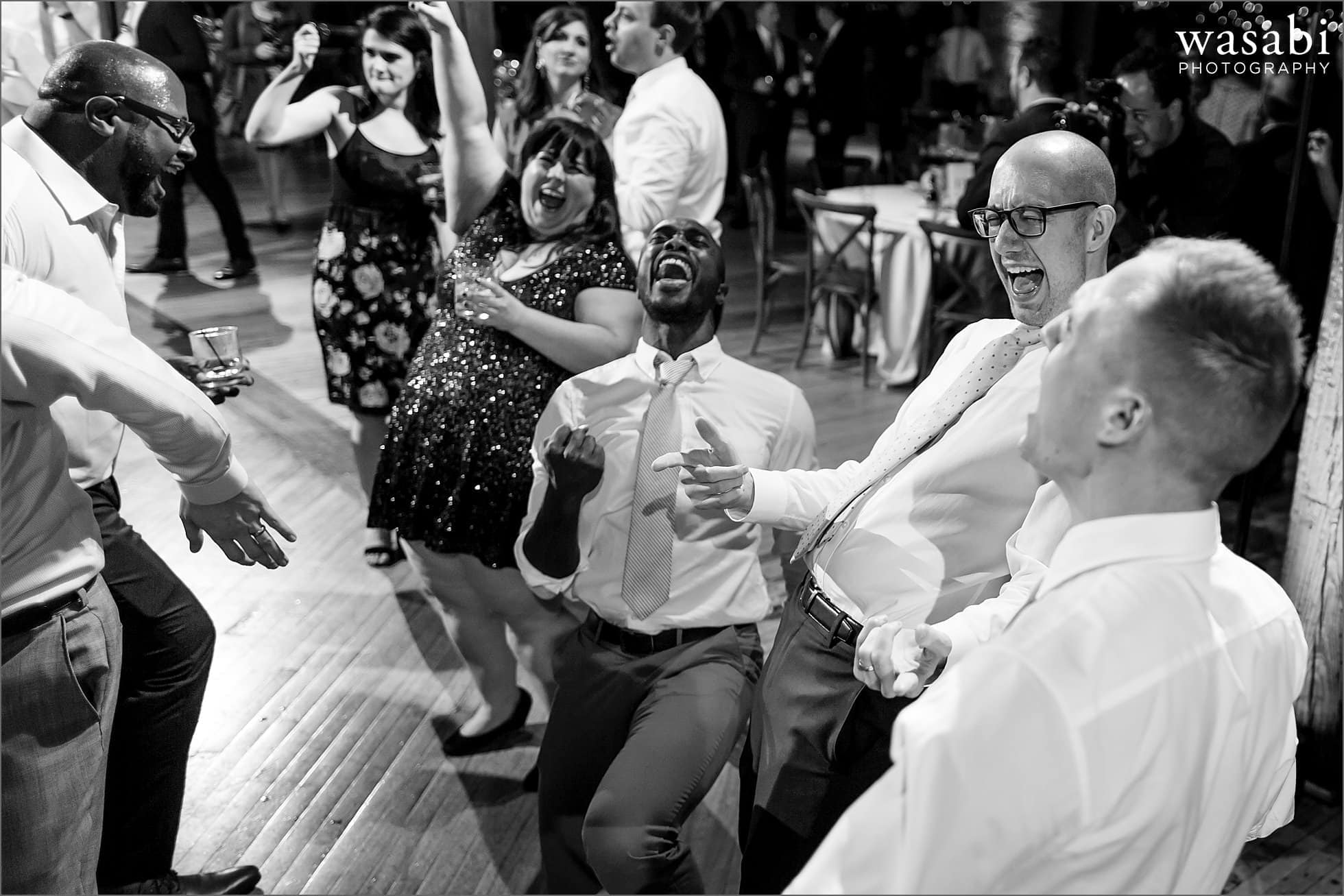 wedding guests sing along with emotion during reception at Skyline Loft