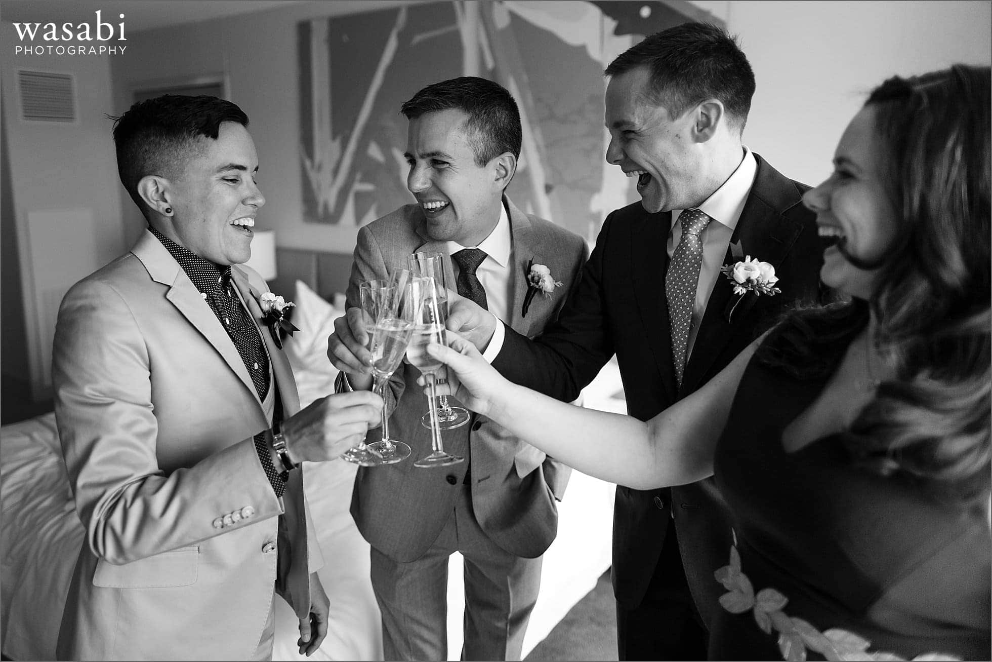 wedding party champagne toast while grooms get ready at marriott magnificent mile in Chicago