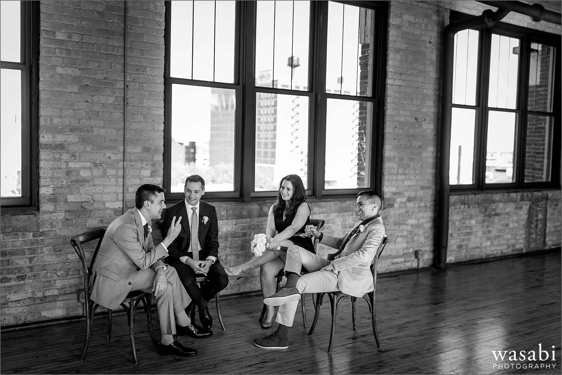 wedding party sits and relaxes before wedding ceremony at Bridgeport Art Centers Skyline Loft