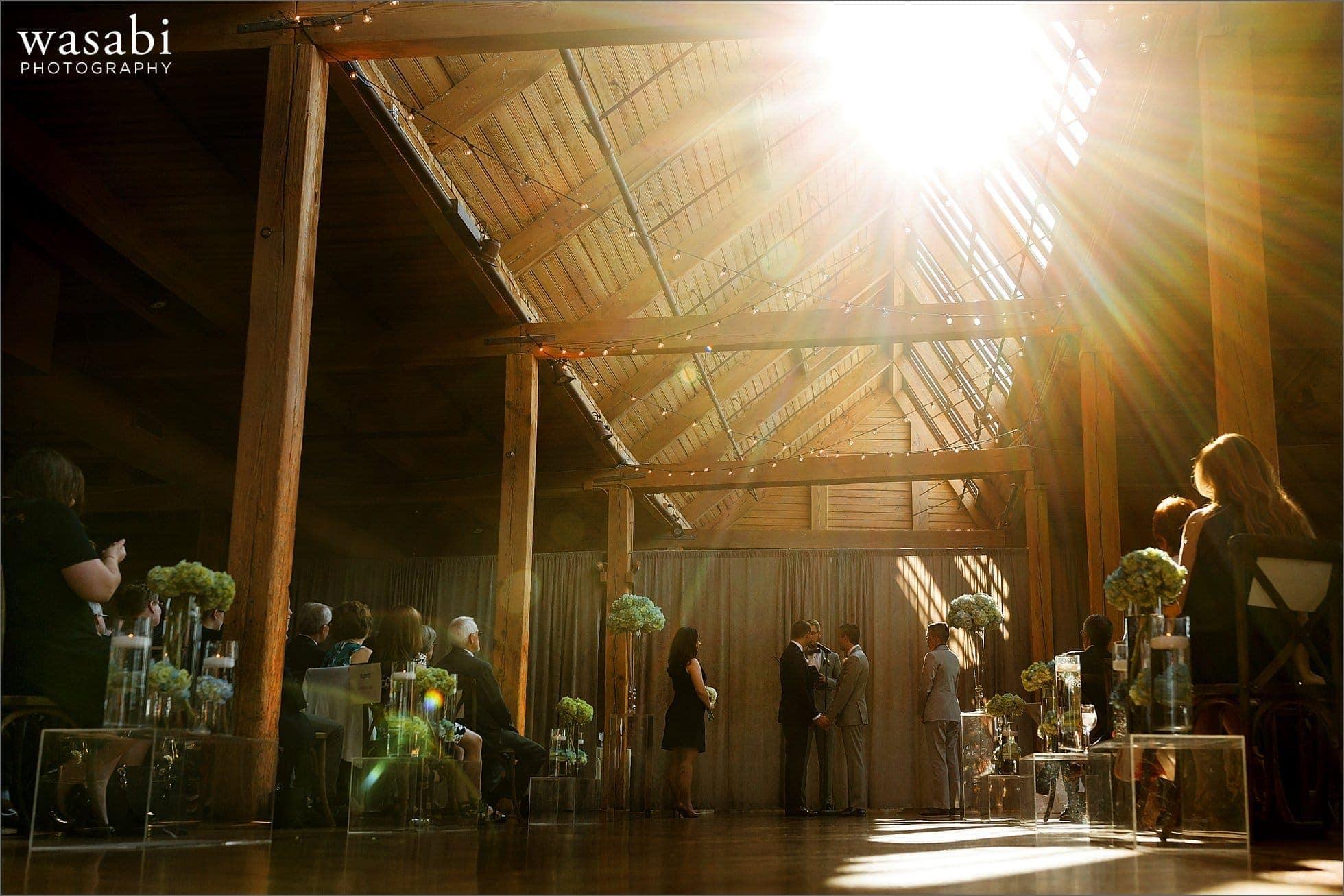 wide shot showing wedding ceremony at Skyline Loft at Bridgeport Art Center in Chicago