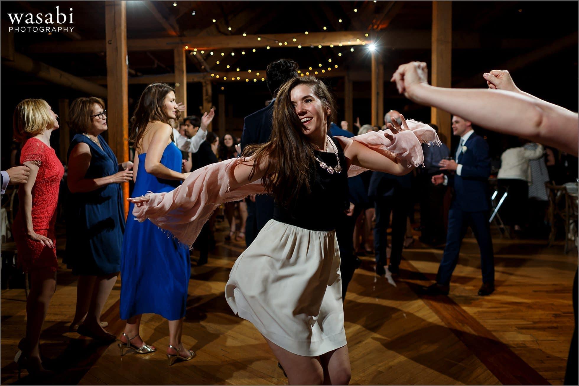 woman dances during wedding reception at Bridgeport Art Centers Skyline Loft
