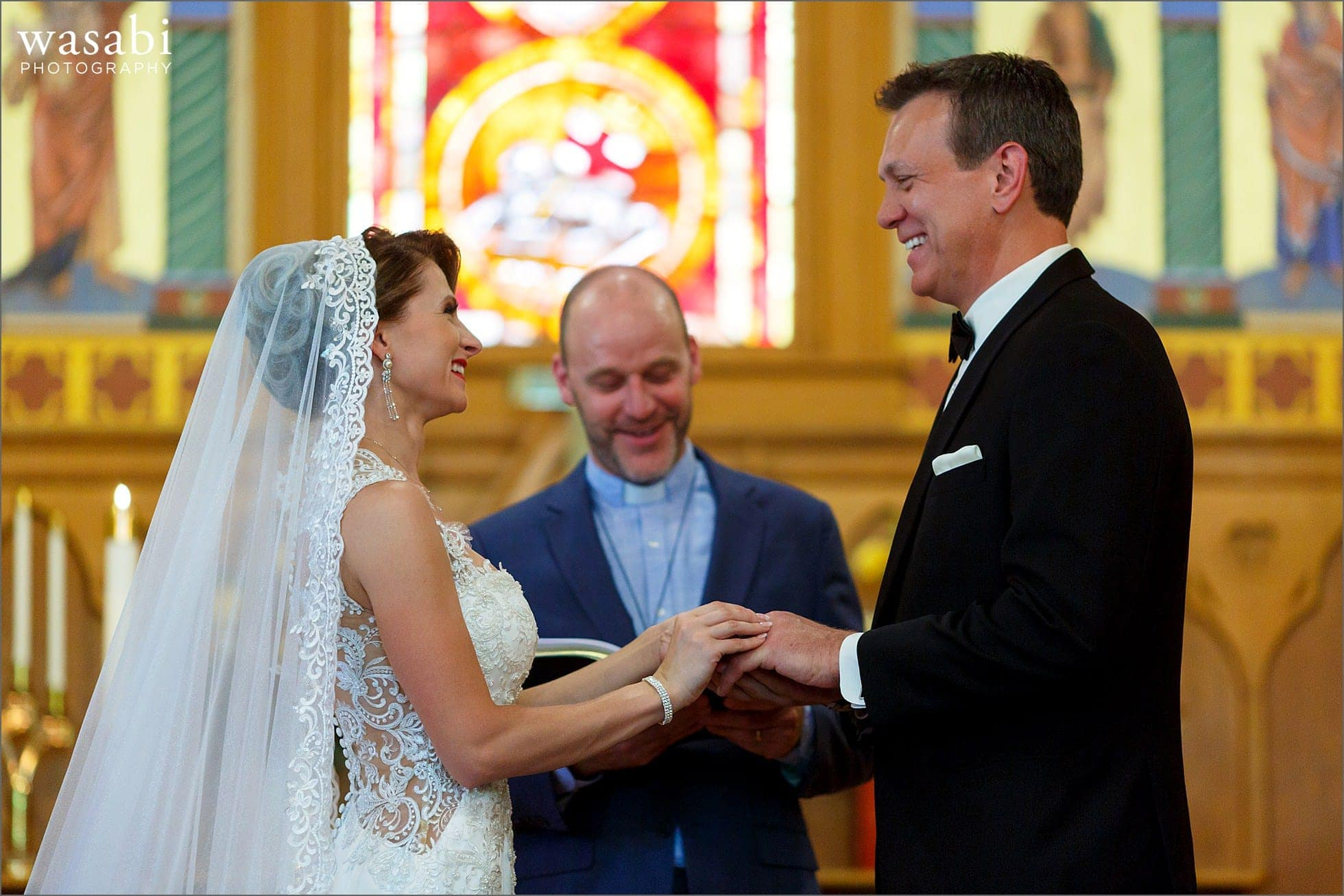 bride and groom hold hands during wedding ceremony at Calvary Church in downtown Golden Colorado
