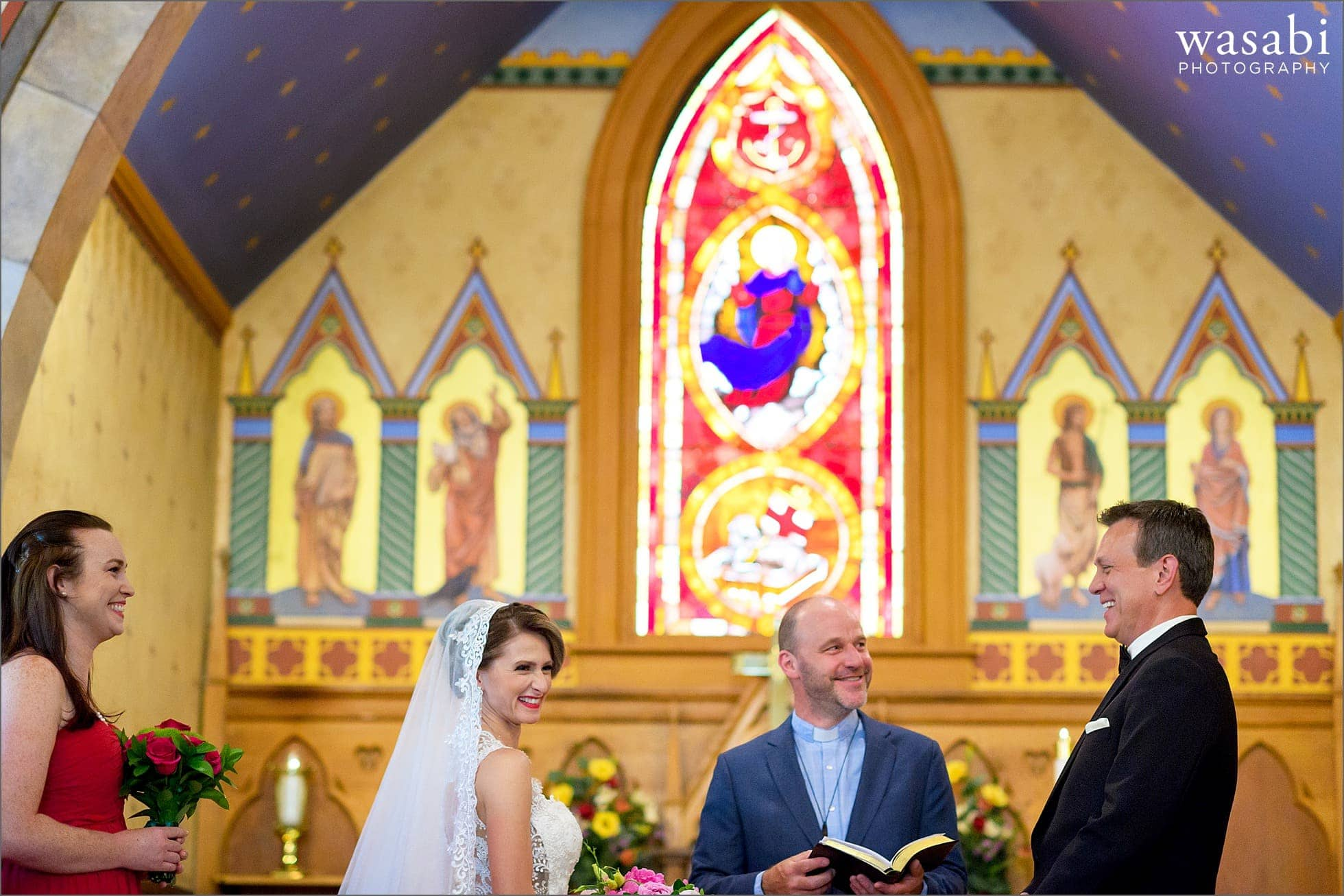 bride and groom laughs during ceremony at Calvary Church in downtown Golden Colorado