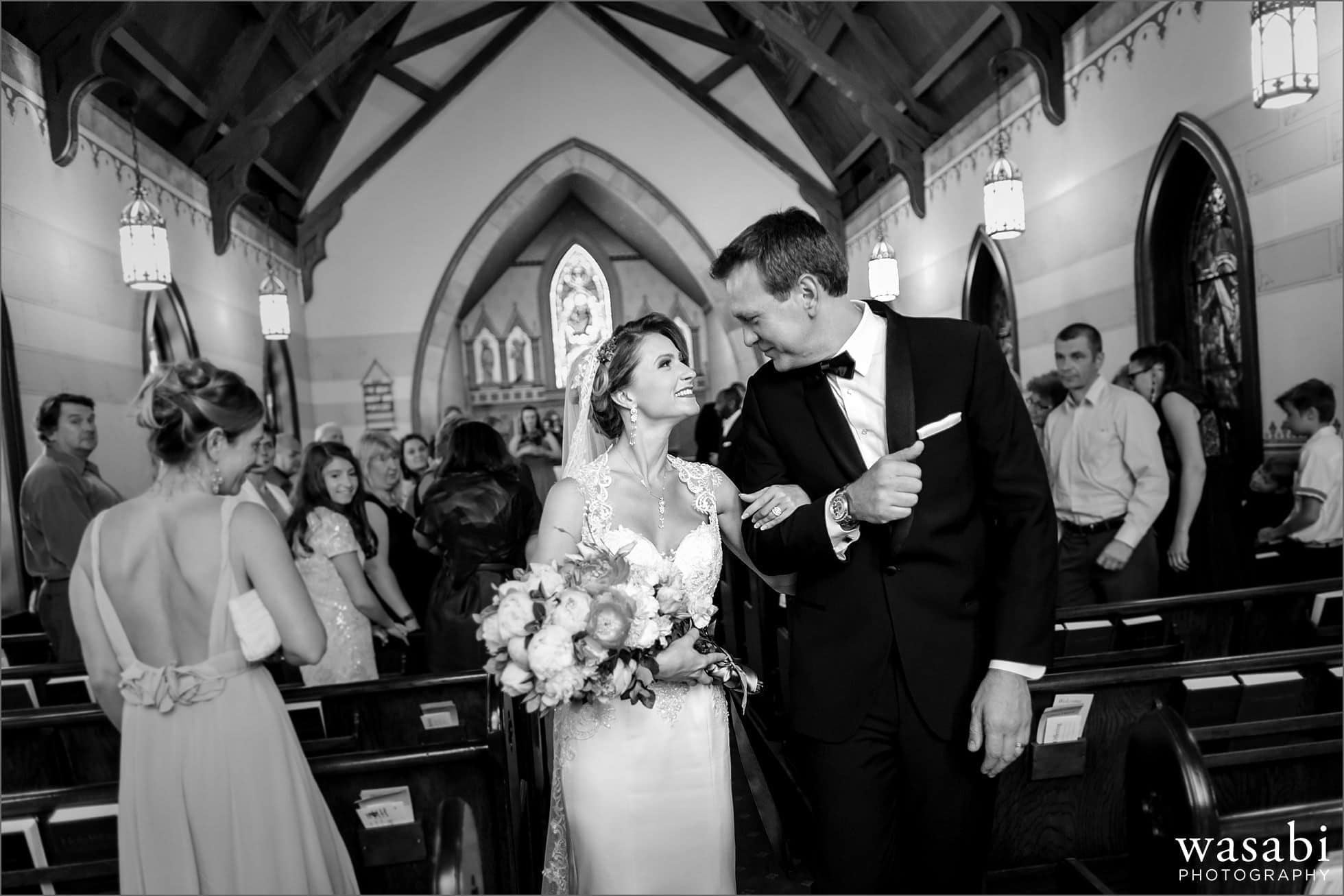 bride and groom walk down the aisle after being married at Calvary Church in downtown Golden Colorado