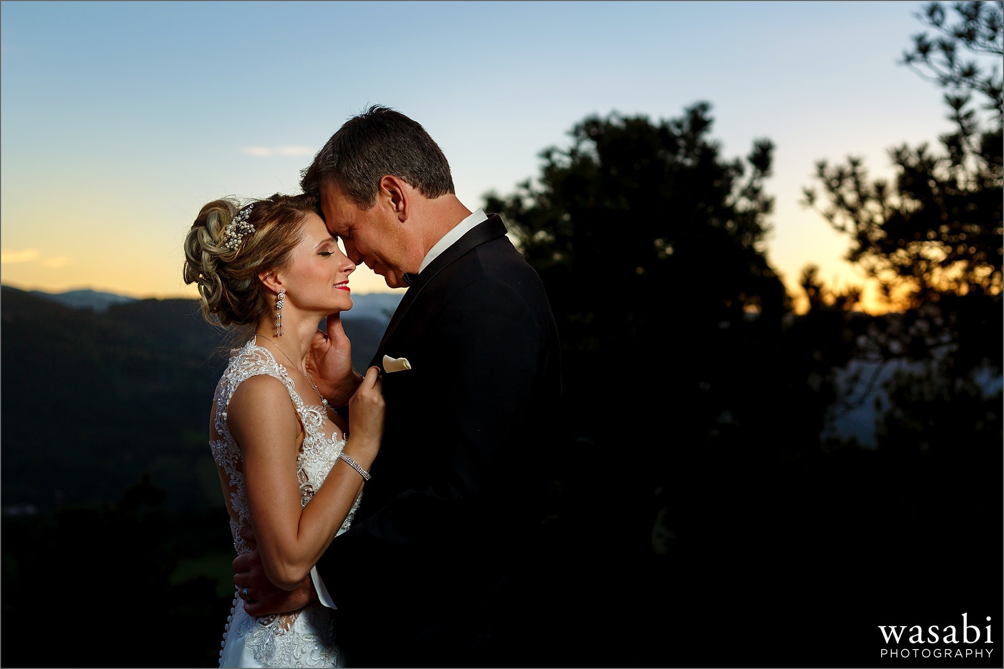 bride and groom wedding photo during sunset - Lookout Mountain wedding photos in Golden Colorado