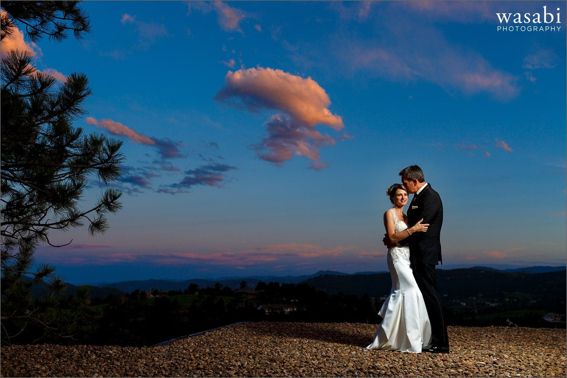 bride and groom wedding portrait with blue sky, clouds and Rocky Mountains - Lookout Mountain wedding photos in Golden Colorado